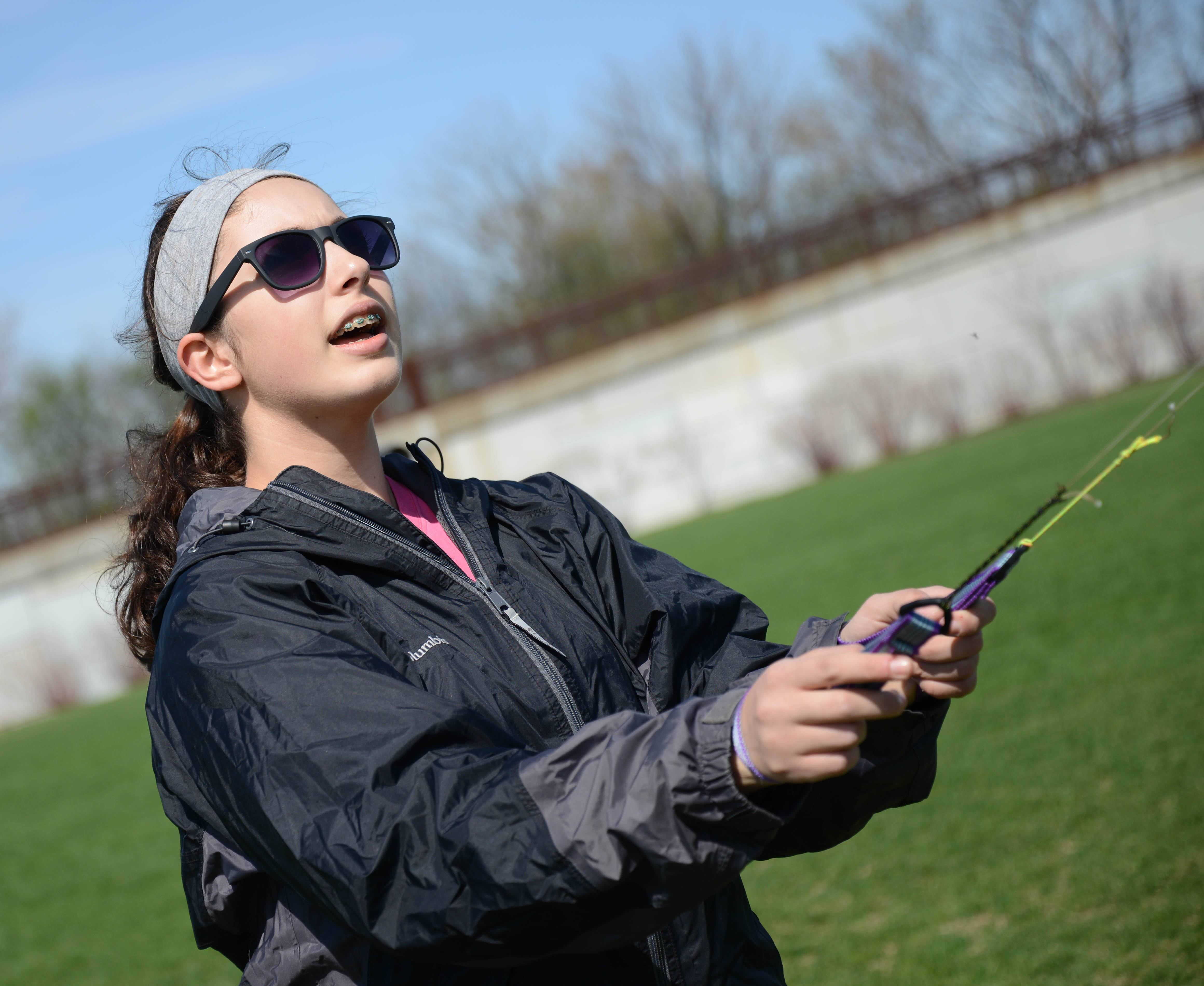 Elizabeth Gordon of Oak Lawn showed off some kite tricks Saturday at Wheaton's Graf Park.