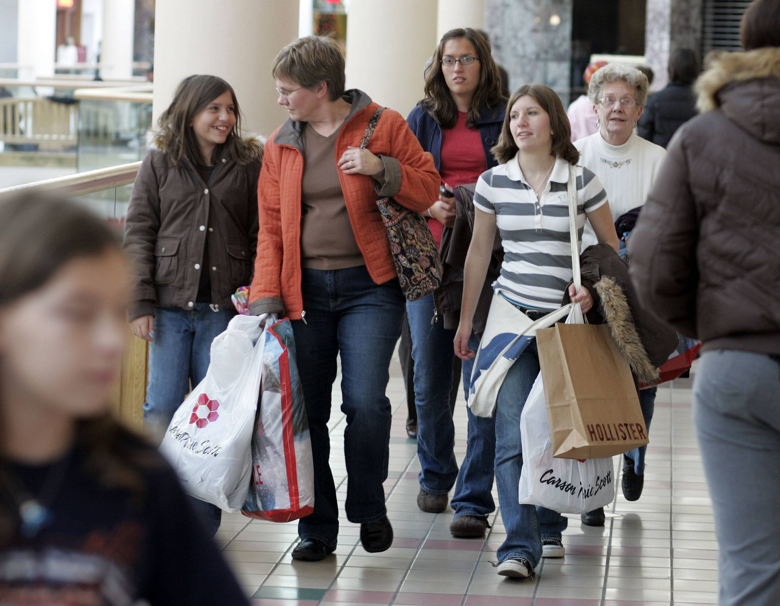 Shoppers carry their bags full of purchases as they make their way through Charlestowne Mall in St. Charles in 2007. When the mall opened 23 years ago it was a go-to place for shopping. Now it's being revamped at The Quad after several years of being virtually vacant.