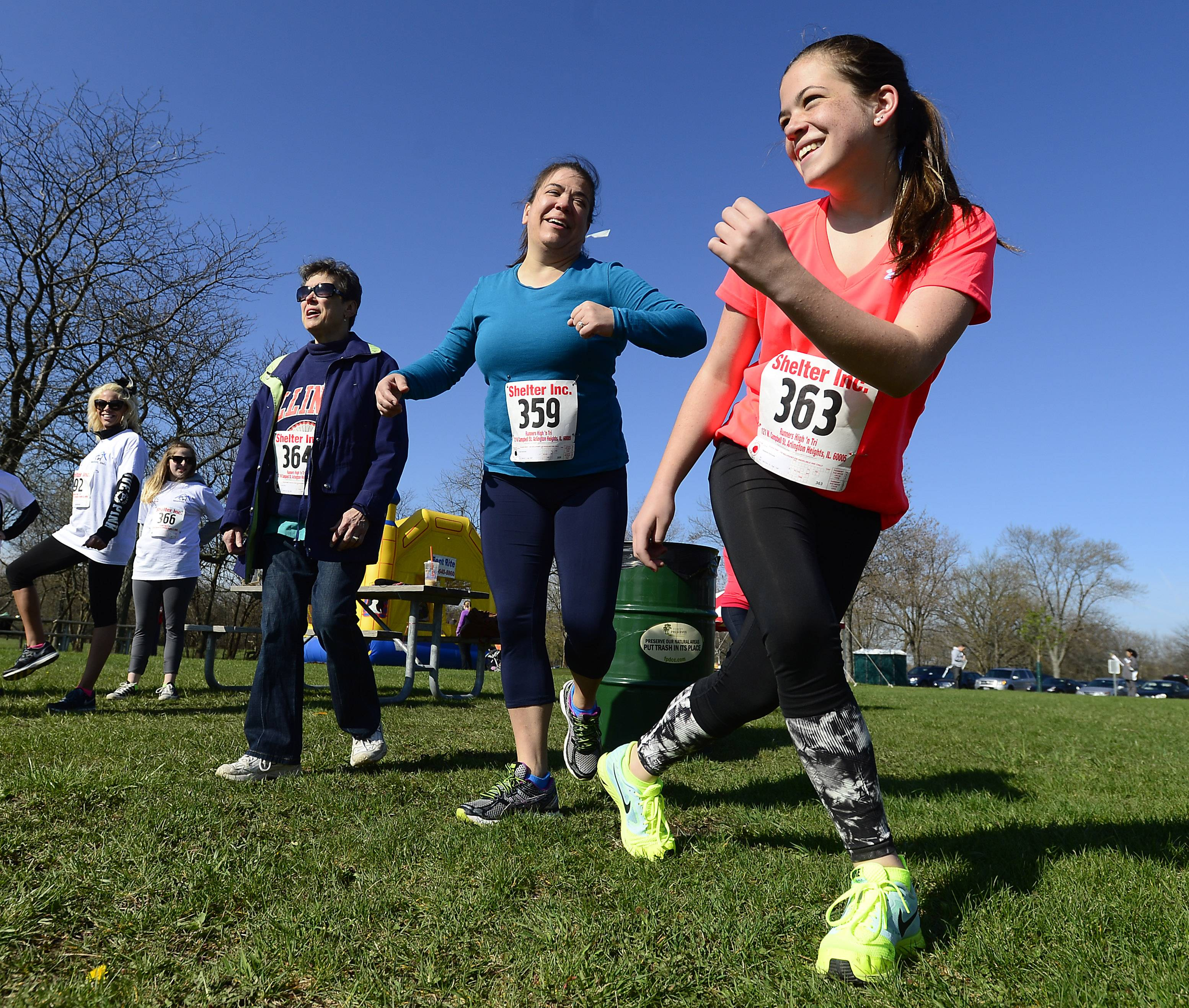 Alex Bartkowiak, 14, and her mom Vicki Bartkowiak and grandmother Karen Wonak of Elk Grove Village warm up before the start of the Shelter 5K Run/Walk Saturday in Busse Woods.