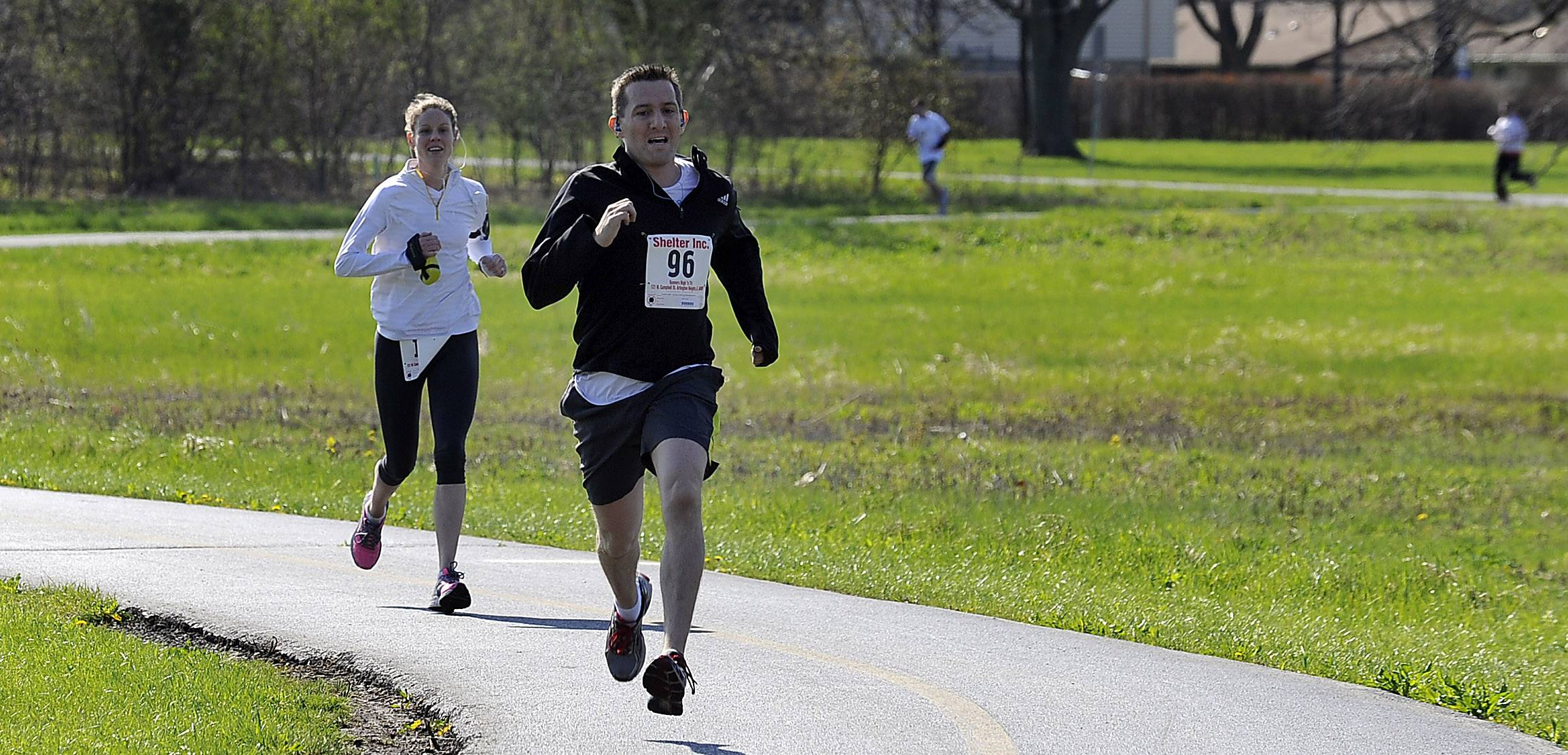 "Gabriel Chavez of Woodridge claims first in the Shelter 5K Run/Walk in Busse Woods on Saturday, beating out Allison Evans of Arlington Heights, who has done the race for three years. Chavez found the race ""exhausting,"" stating that it's only the second time in 17 years that he has run in an event like this."