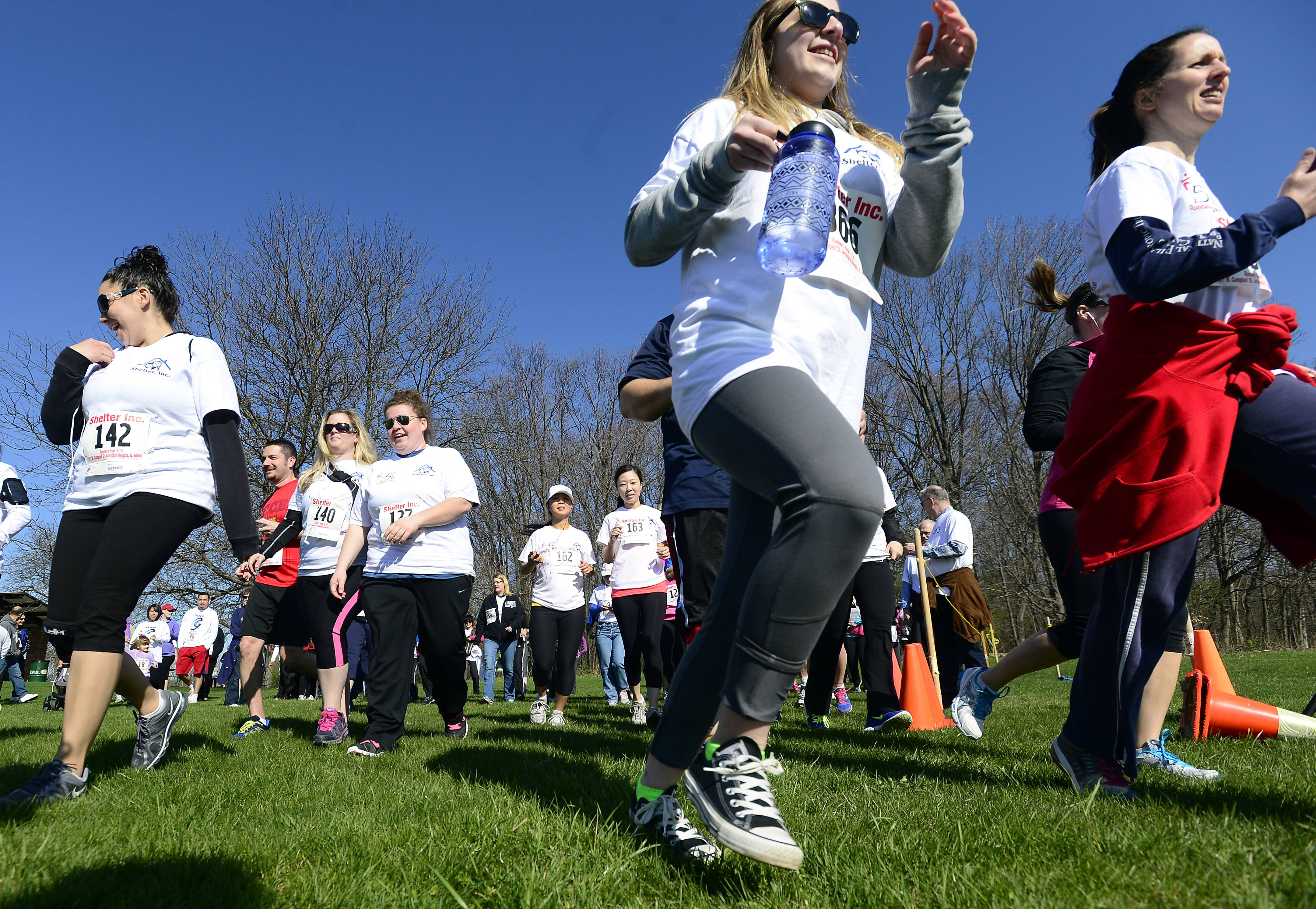 More than 200 runners and walkers under a beautiful blue sky Saturday kicked off the start of the Shelter 5K Run/Walk in Busse Woods. Some runners were with dogs, others with baby strollers as they showed support for the effort to help abused children.