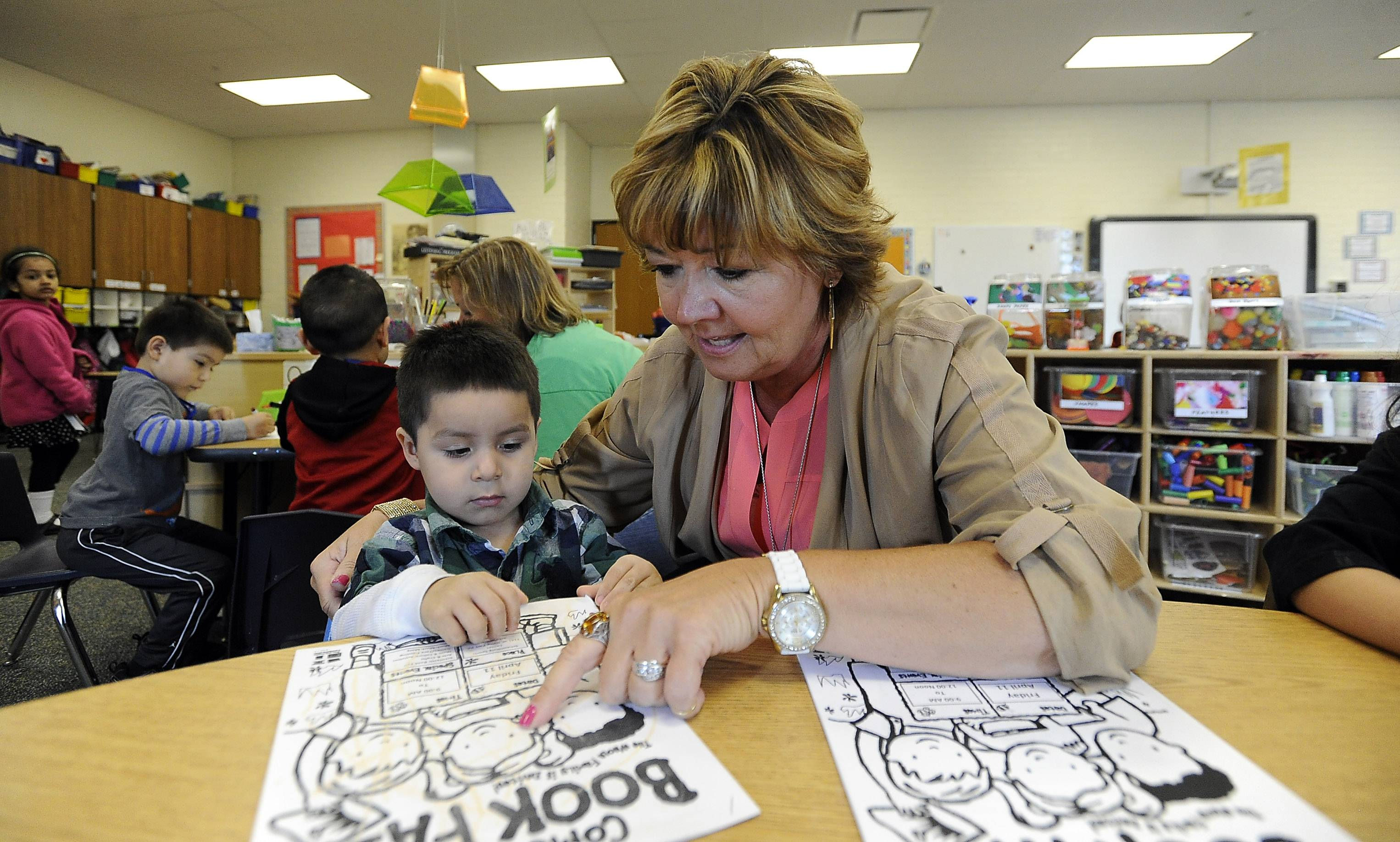 Schaumburg Township Elementary District 54 Early Childhood Director Sue Mayernick works with Hector Benitez, 3, at Keller Junior High School in Schaumburg.