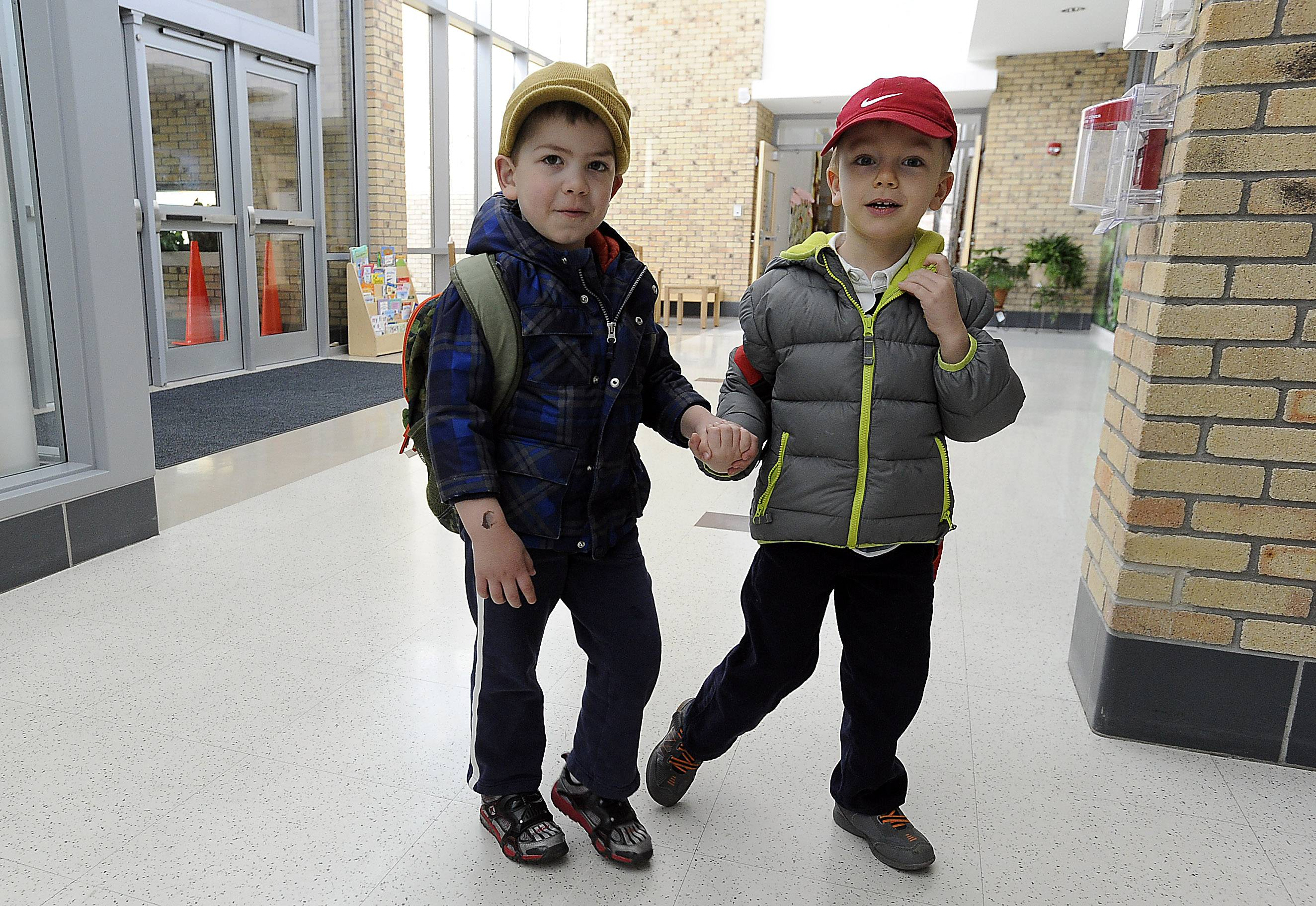 Students Brayden Pendzimaz, left, and Adrian Wudzinski walk to class at Barrington Unit District 220's Early Learning Center in Barrington.