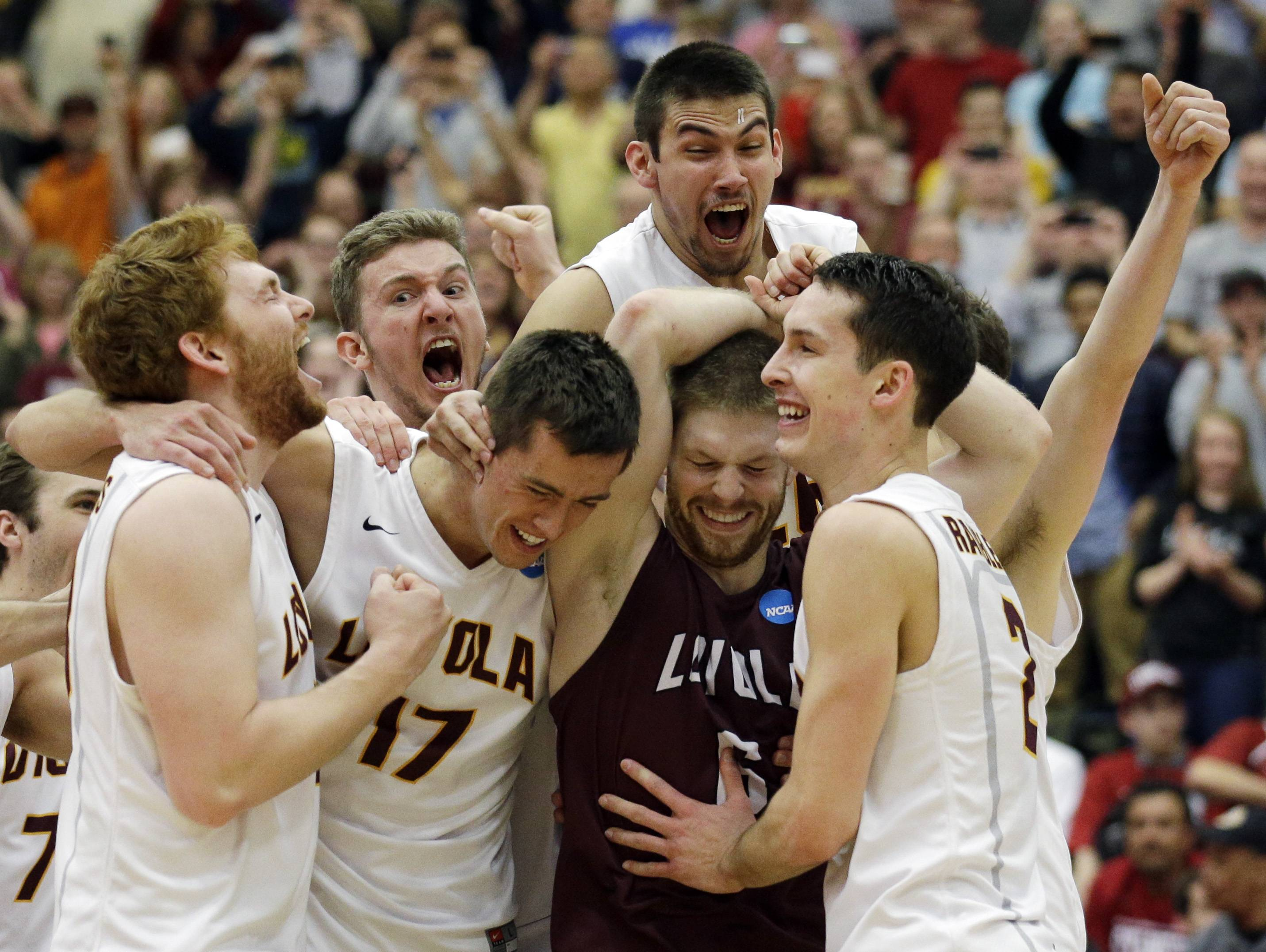 Loyola players celebrate Saturday after they defeated Stanford 3-1 in the NCAA men's volleyball championship at Gentile Arena.