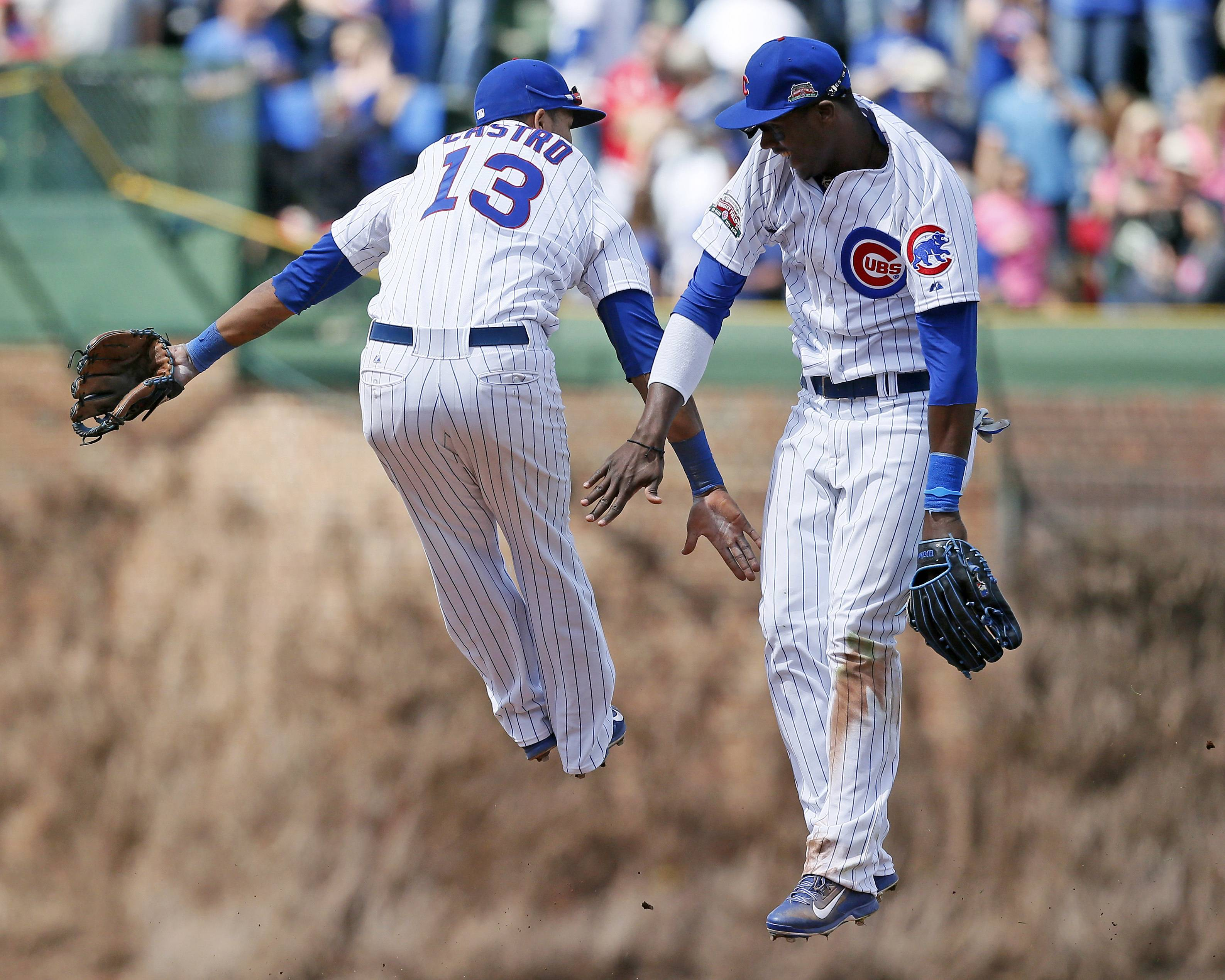 Starlin Castro, left, and Junior Lake celebrate after the Cubs beat the Cardinals at Wrigley Field.