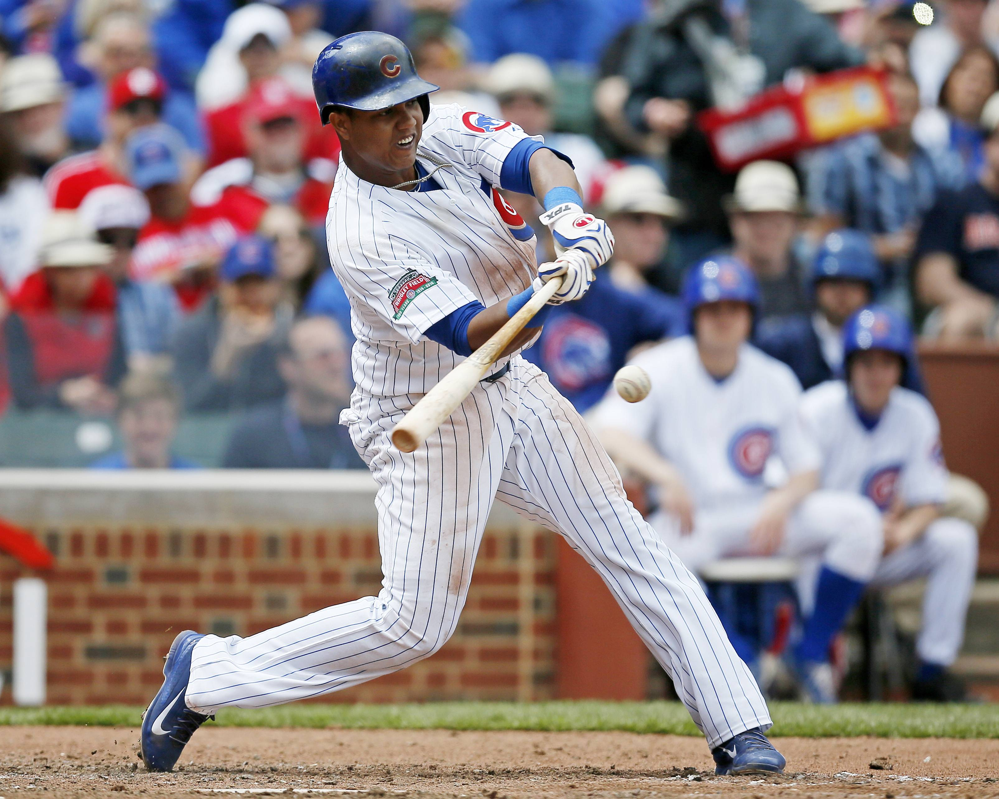 Cubs' Starlin Castro connects for a single against the St. Louis Cardinals during the sixth inning of a baseball game on Saturday, May 3, 2014, in Chicago.