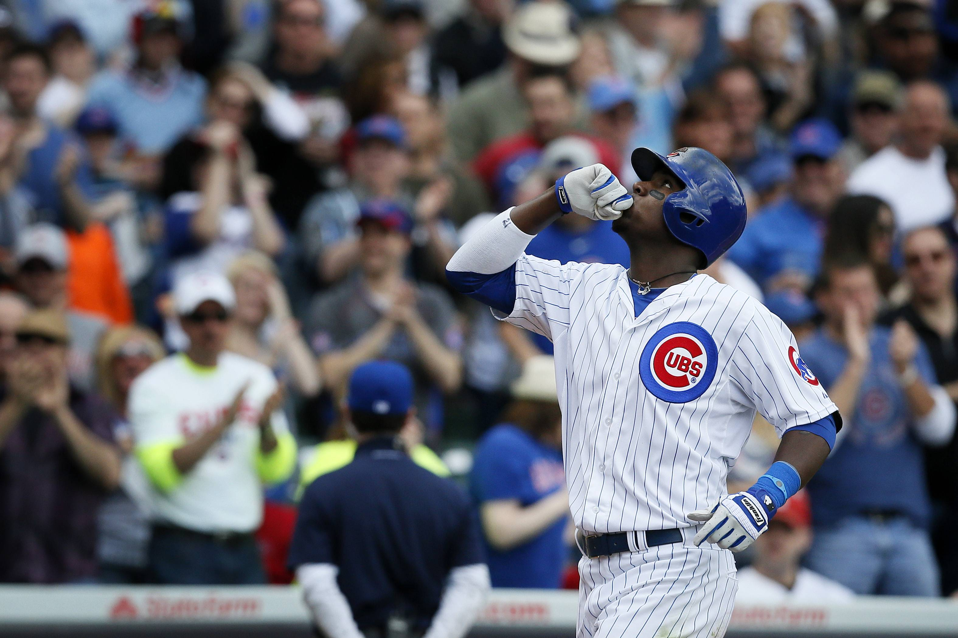 Junior Lake celebrates after hitting a 2-run homer in the sixth inning that gave the Cubs a 2-0 lead over St. Louis.