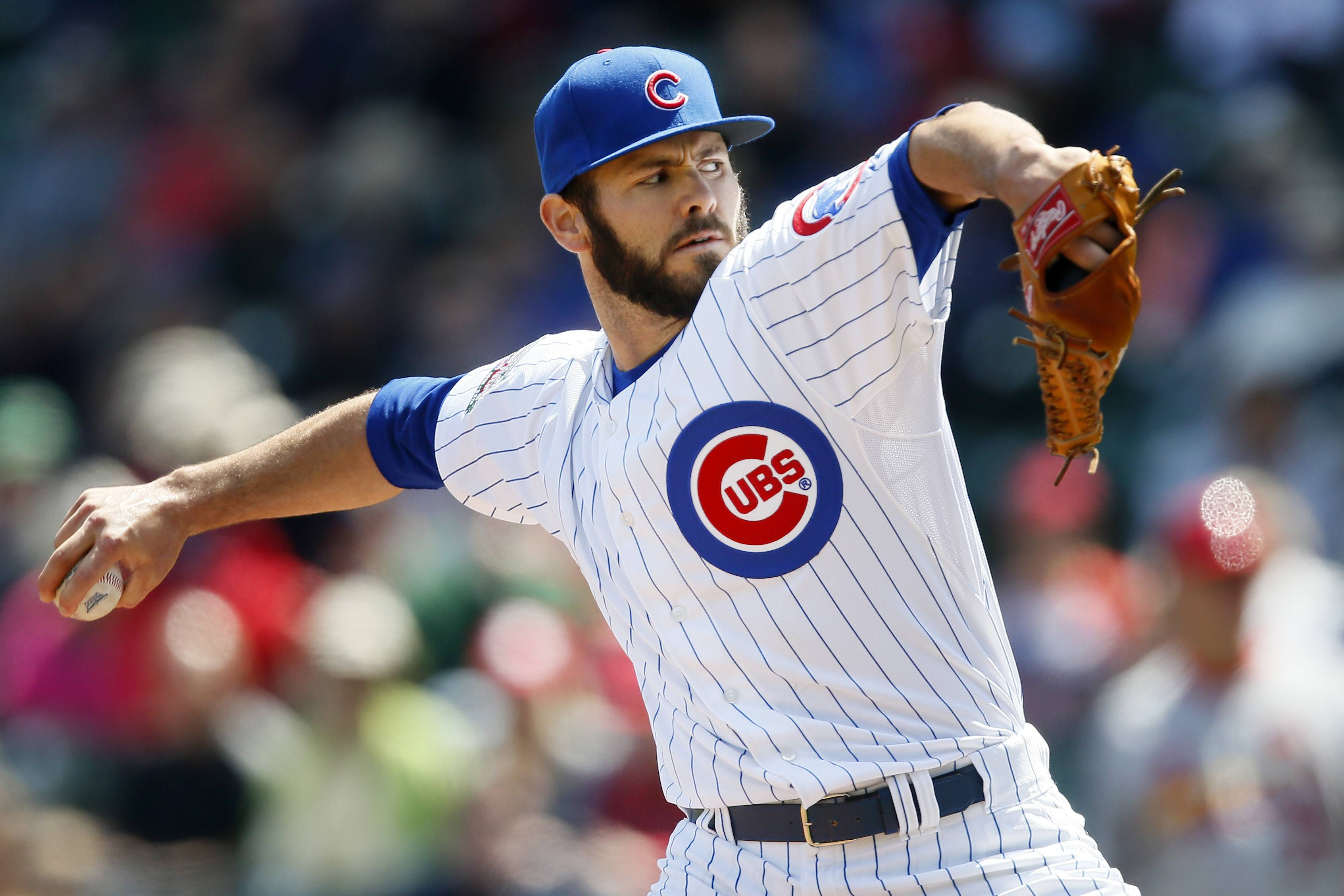 Cubs starting pitcher Jake Arrieta delivers against the St. Louis Cardinals during the first inning of a baseball game on Saturday, May 3, 2014, in Chicago.