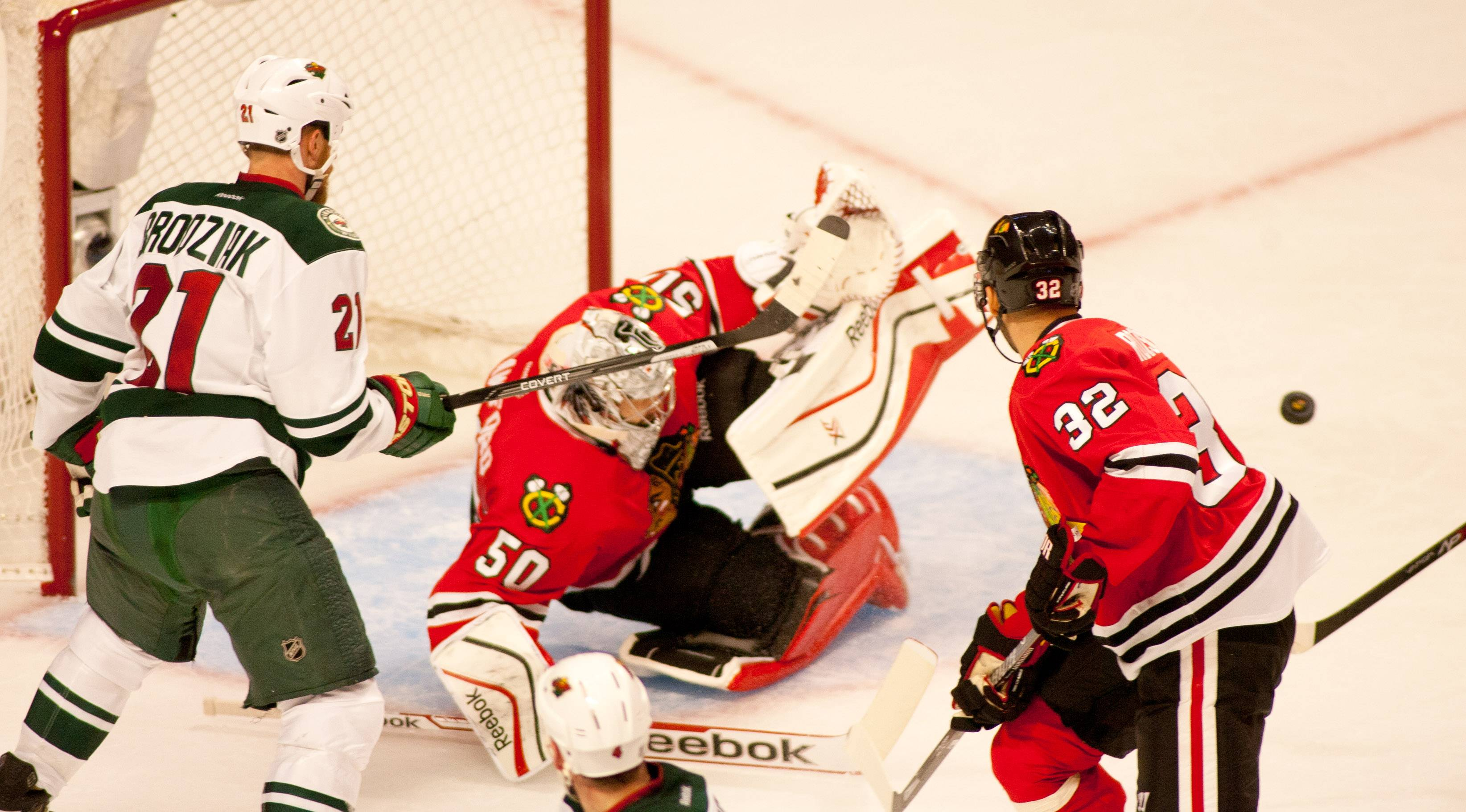 Blackhawks goalie Corey Crawford makes a second-period save Friday night in Game 1 against the Wild.