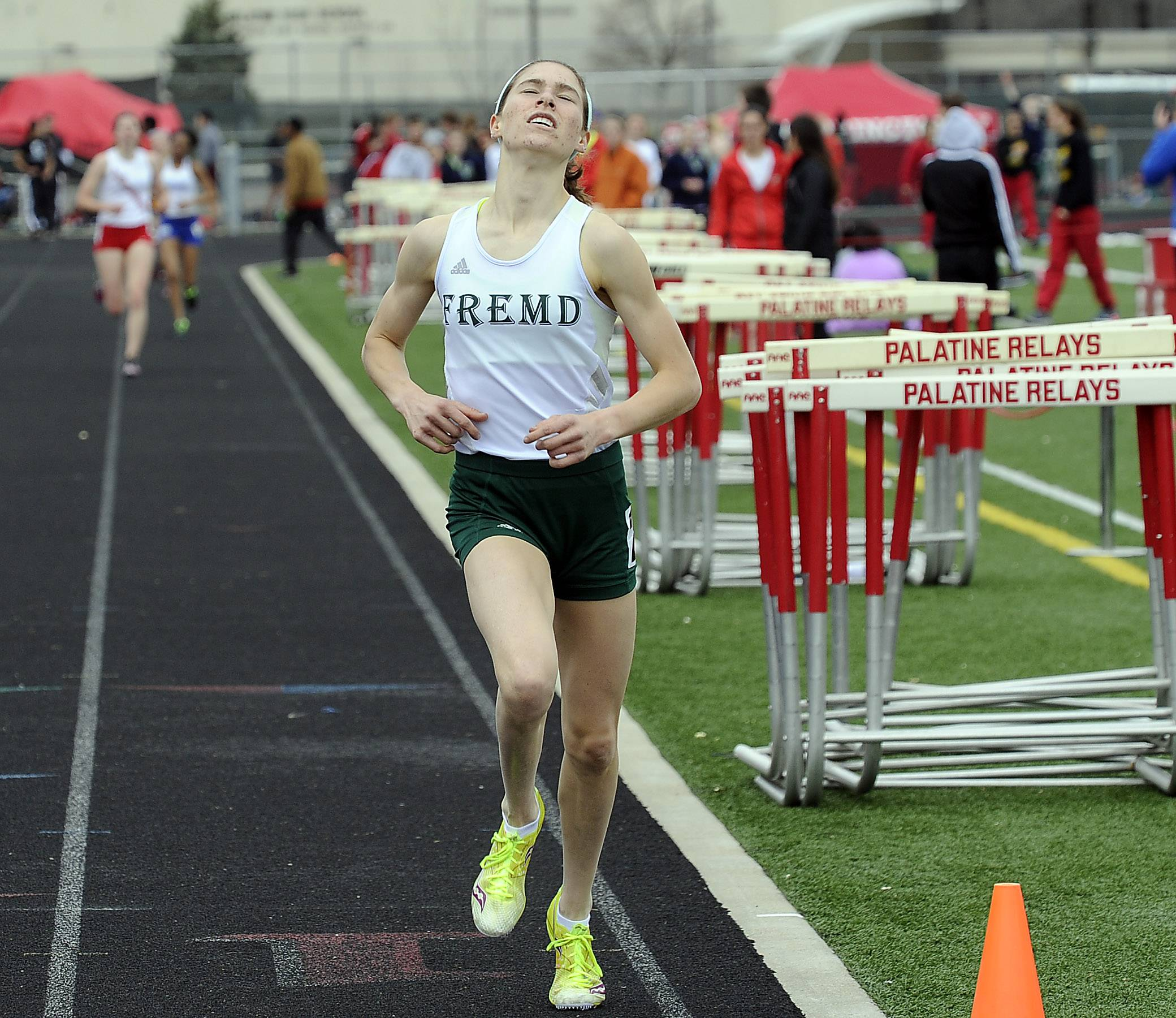 Katie Escobar of Fremd earns a second-place finish in the 1,600 meters at Palatine High School on Saturday.