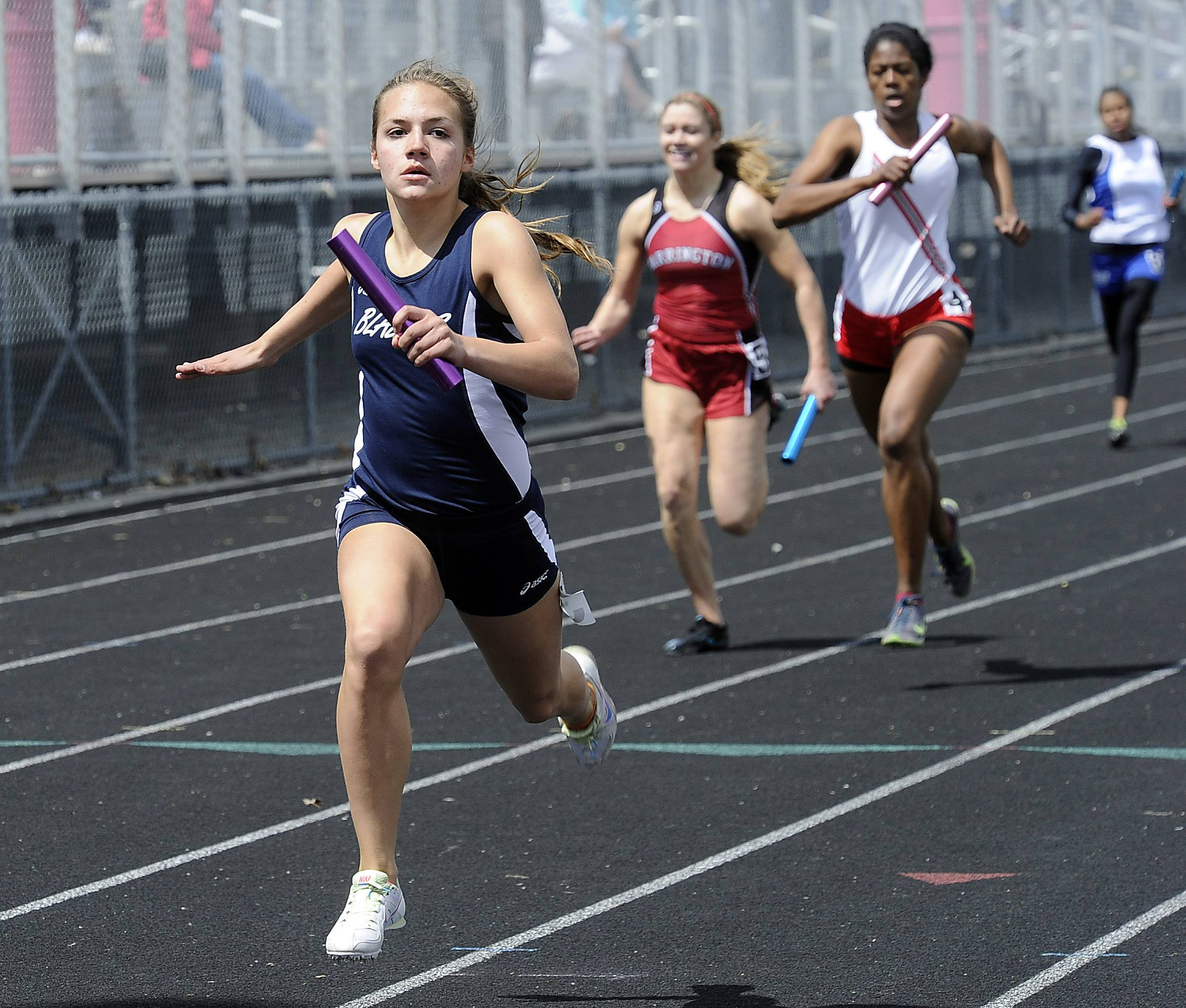 Lauren Kroll of Addison Trail finishes a victory in the 4x200 relay on Saturday at Palatine High School.