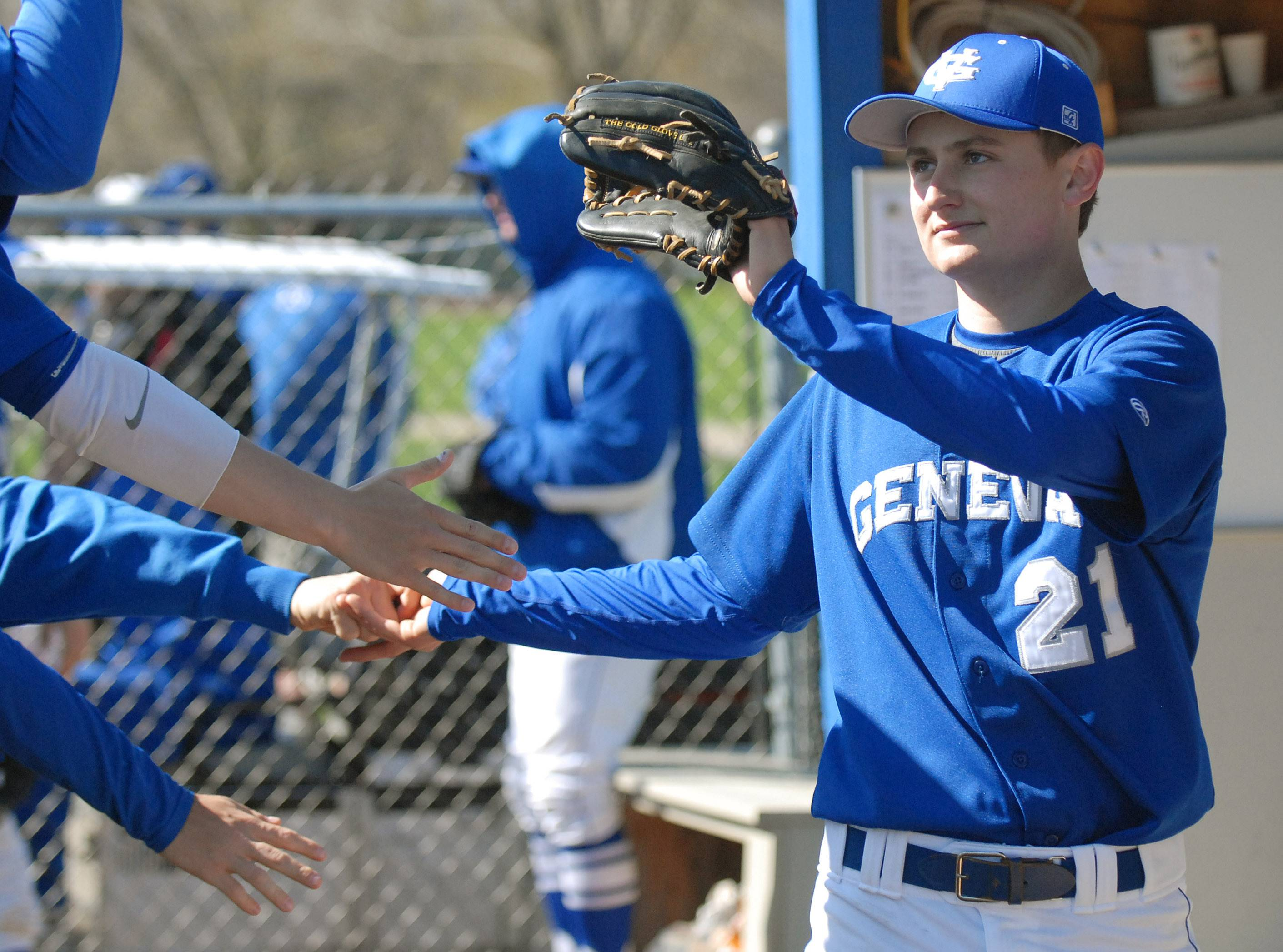 Teammates praise pitcher Geneva's Max Novak in the fourth inning as he returns to the dugout on Saturday, May 3.