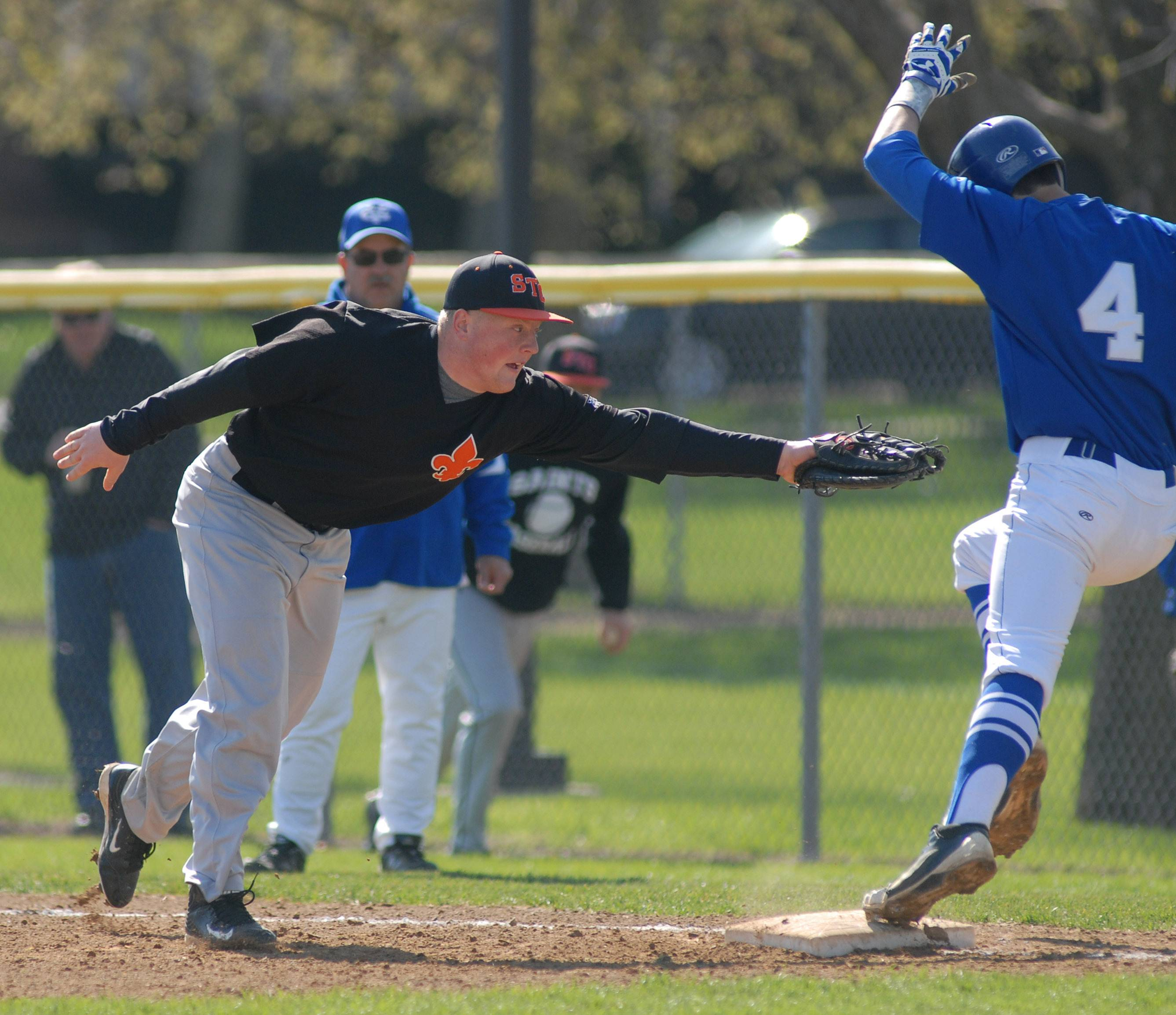 Geneva's Nick Porretto is safe on first base from St. Charles East's Ben Smith in the second inning on Saturday, May 3.