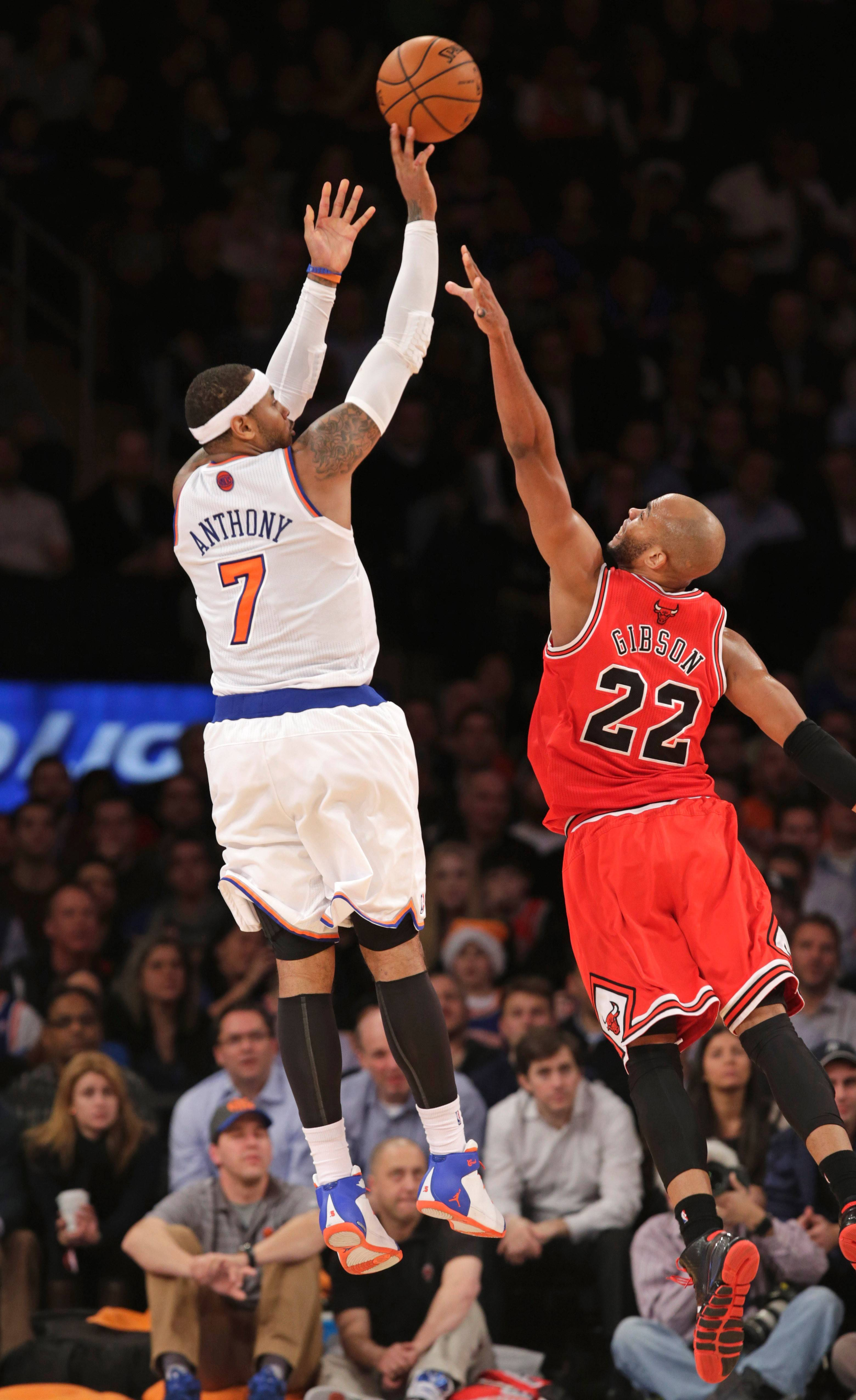 New York Knicks forward Carmelo Anthony (7) shoots over Chicago Bulls forward Taj Gibson (22) in the second half of their NBA basketball game at Madison Square Garden in New York, Wednesday, Dec. 11, 2013. Anthony scored 30 points as the Knicks defeated the Bulls 83-78.