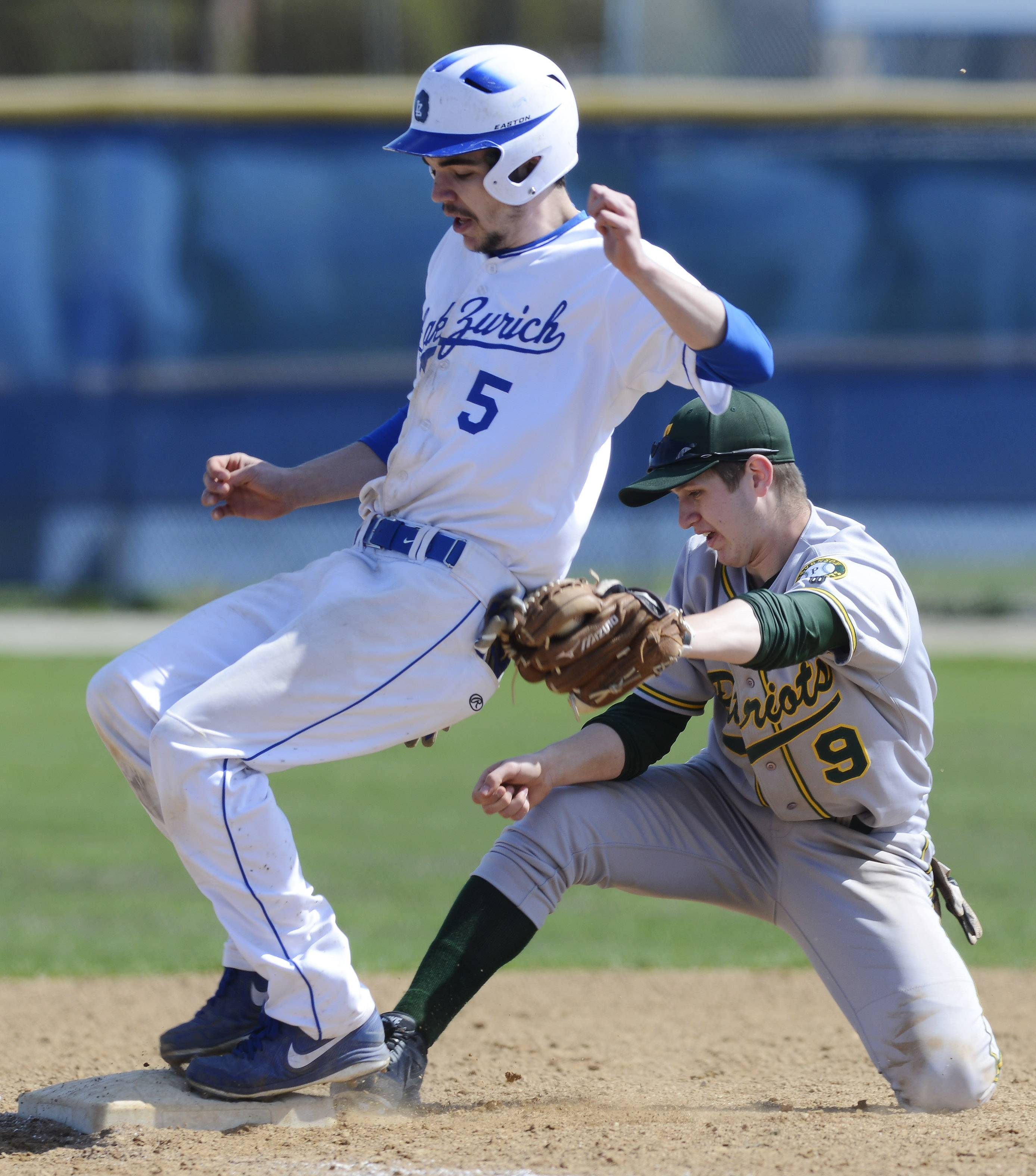 Lake Zurich's Steve Elrod gets tagged out by Stevenson third baseman Sean Wilson on an attempted steal during Saturday's game at Lake Zurich.