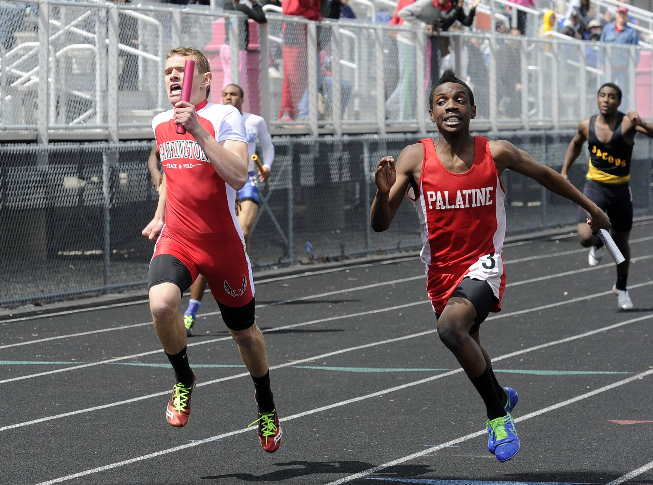 Palatine's Zion Oluleye edges out Barrington's Mark Landwer for a Pirates victory in the 4x200 relay on Saturday at Chic Anderson Field.