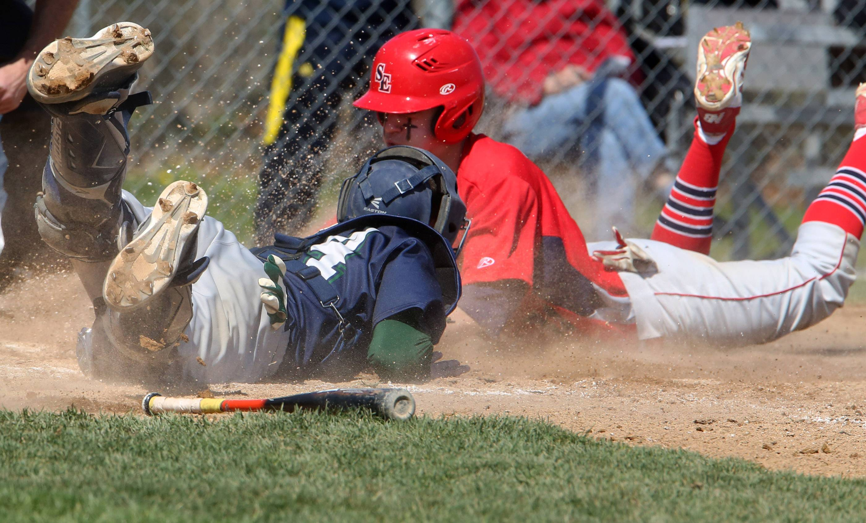 South Elgin's Nick Menken slides safely into home as Bartlett catcher Jordan Flint reaches for the tag on Saturday at South Elgin.