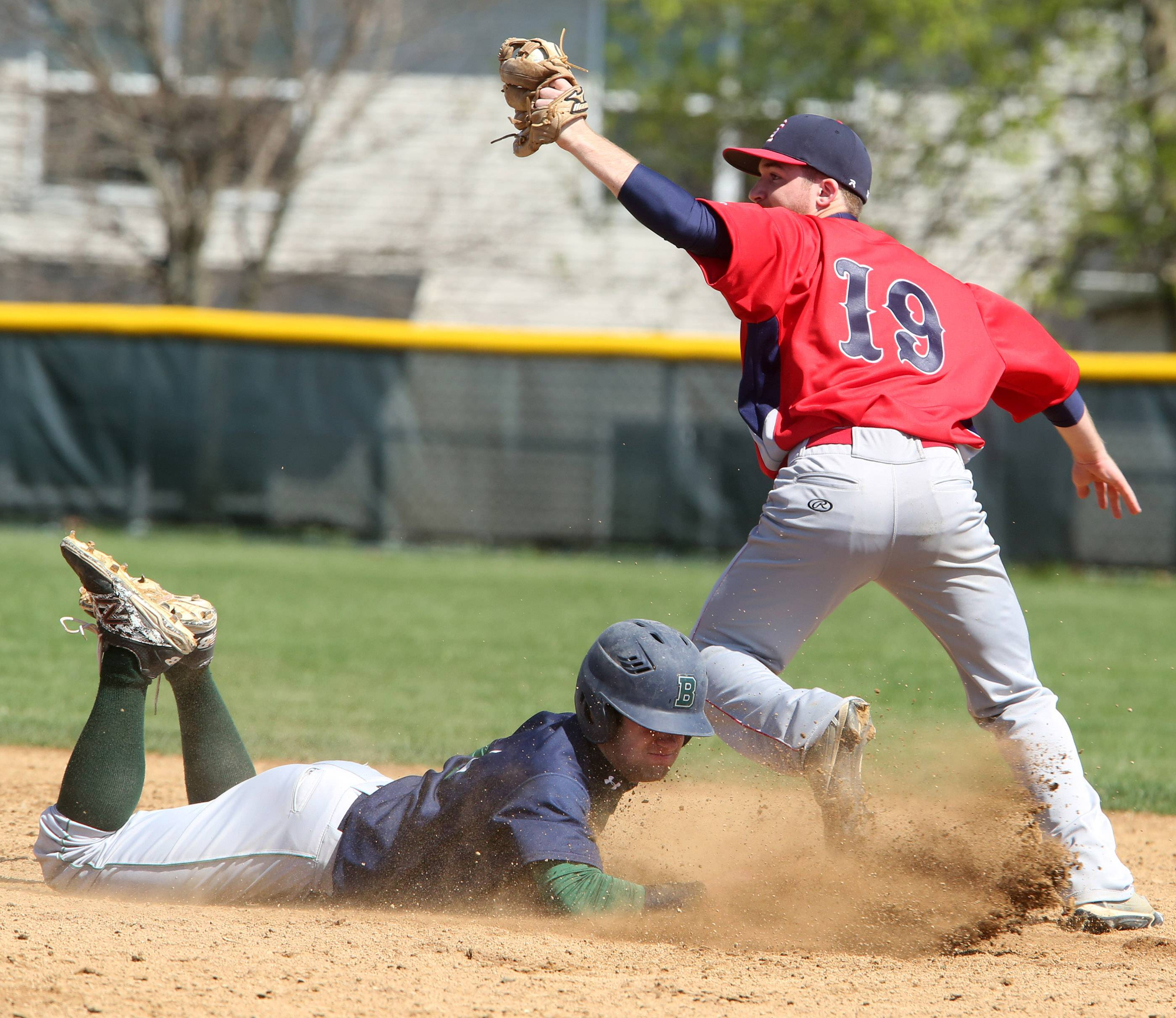 Bartlett's Mike Wick is out diving back to second base as South Elgin's Jared Kramer secures the throw on Saturday at South Elgin.