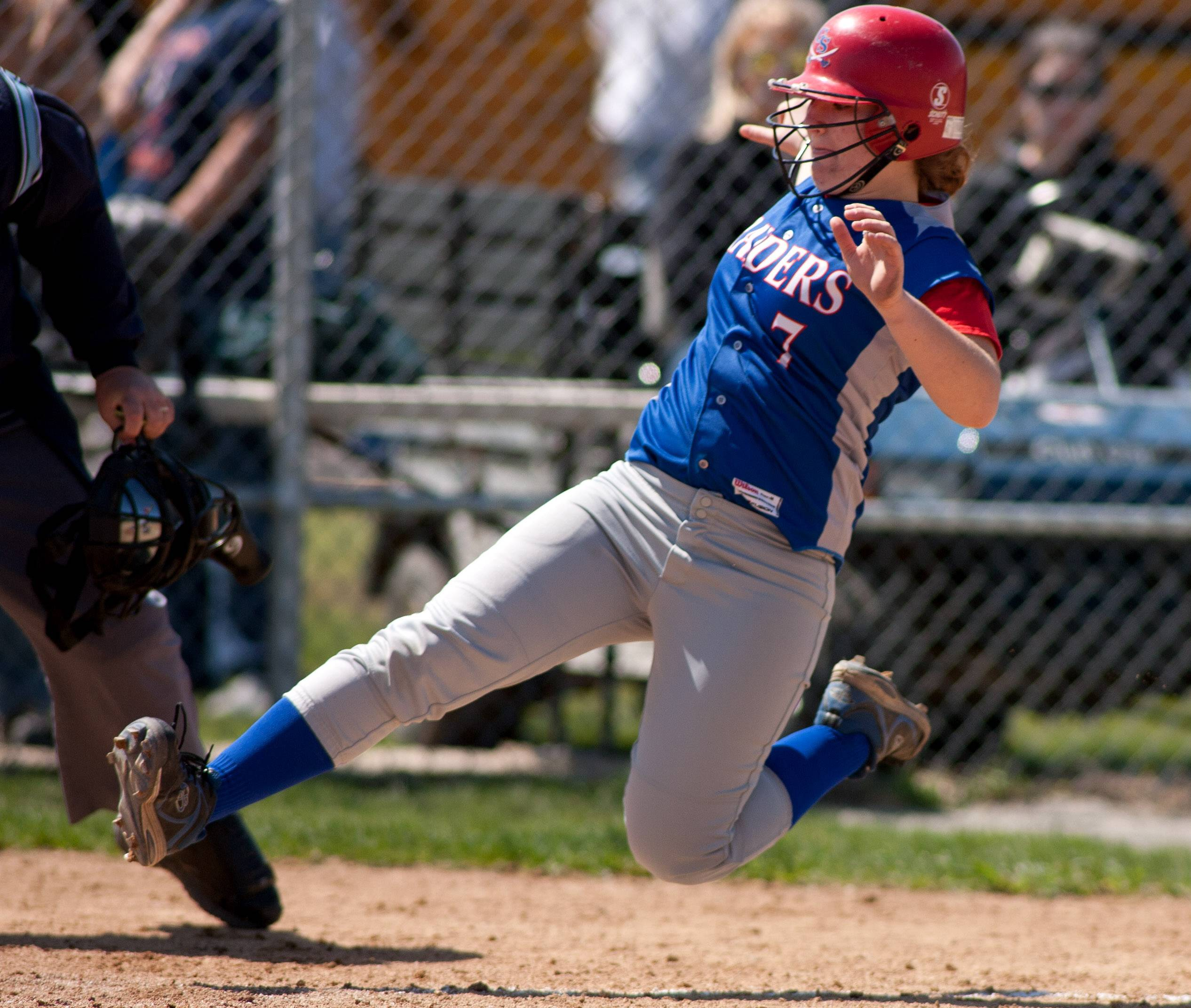 Glenbard South's Holly Taylor slides home for the final run of the game against Morton during girls softball action in Lombard.