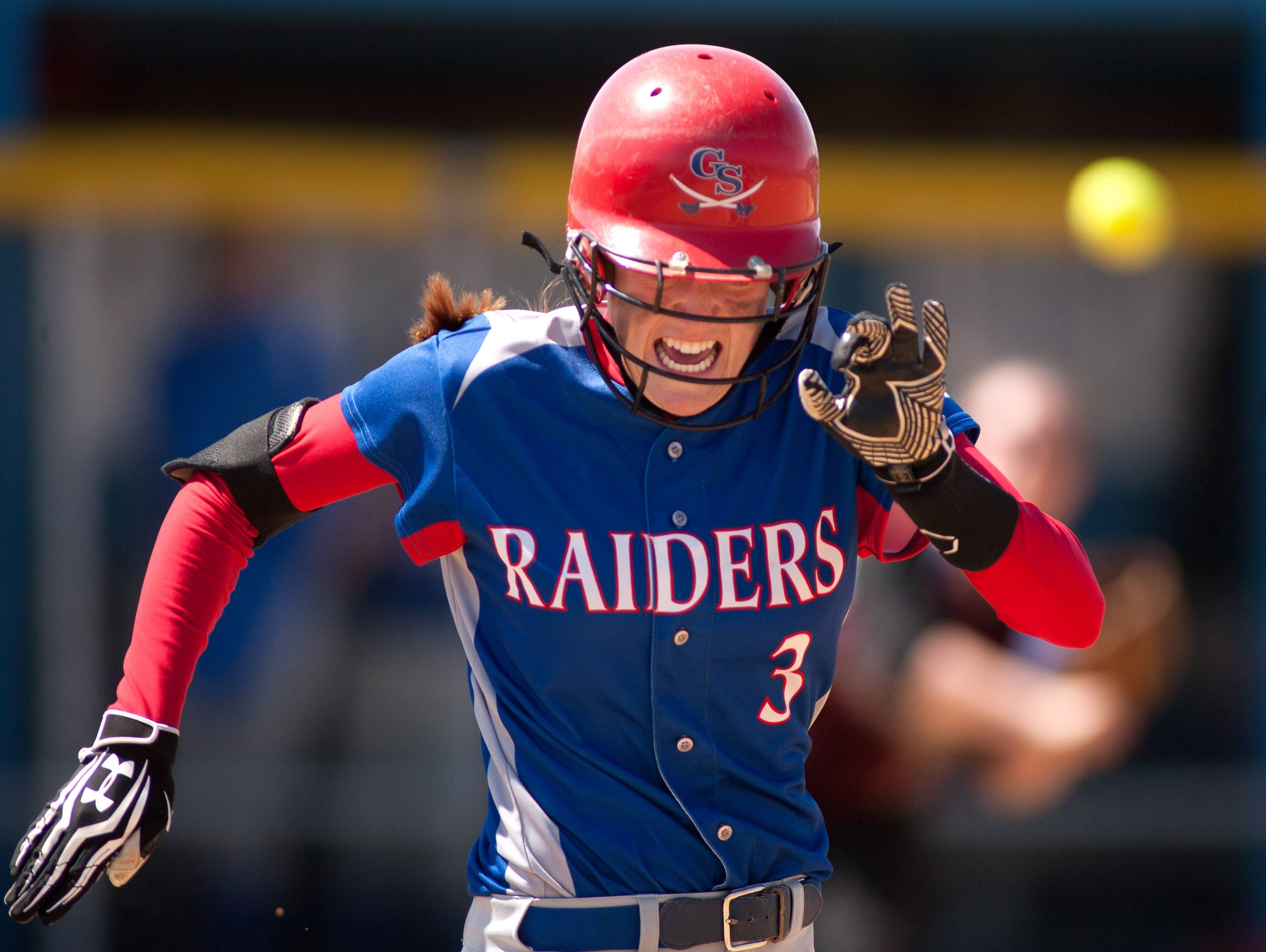 Glenbard South's Tricia Weigand legs out an infield single against Morton during girls softball action in Lombard.
