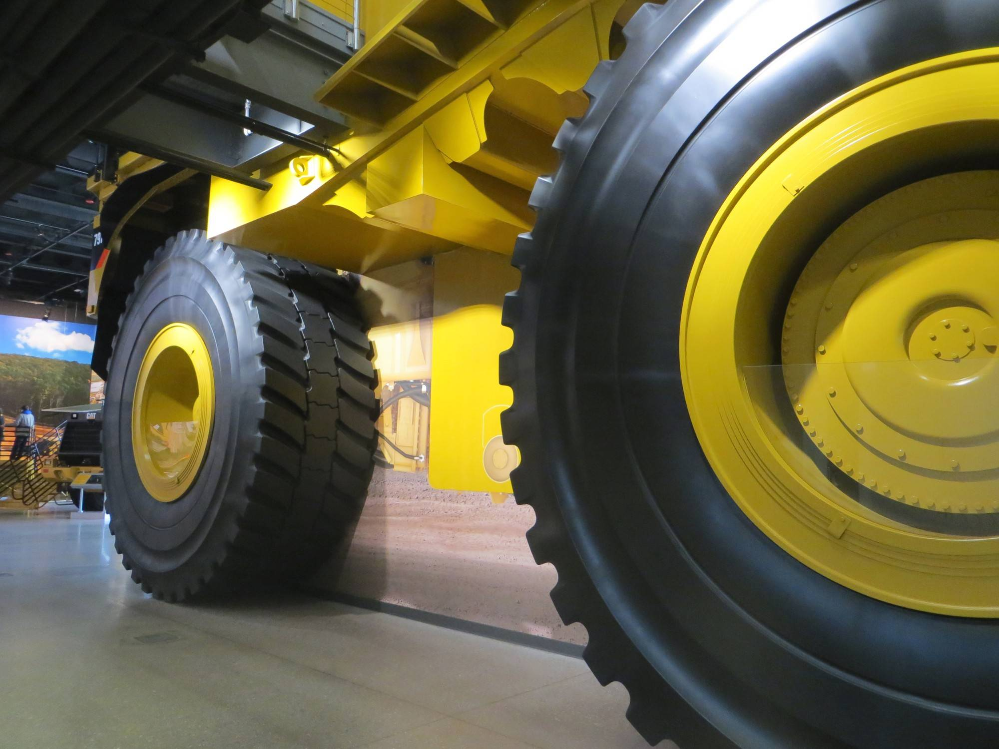 At the Caterpillar Visitors Center in Peoria, Ill., guests watch an introduction video inside the massive mining truck and take photos alongside its 13-foot-tall tires.