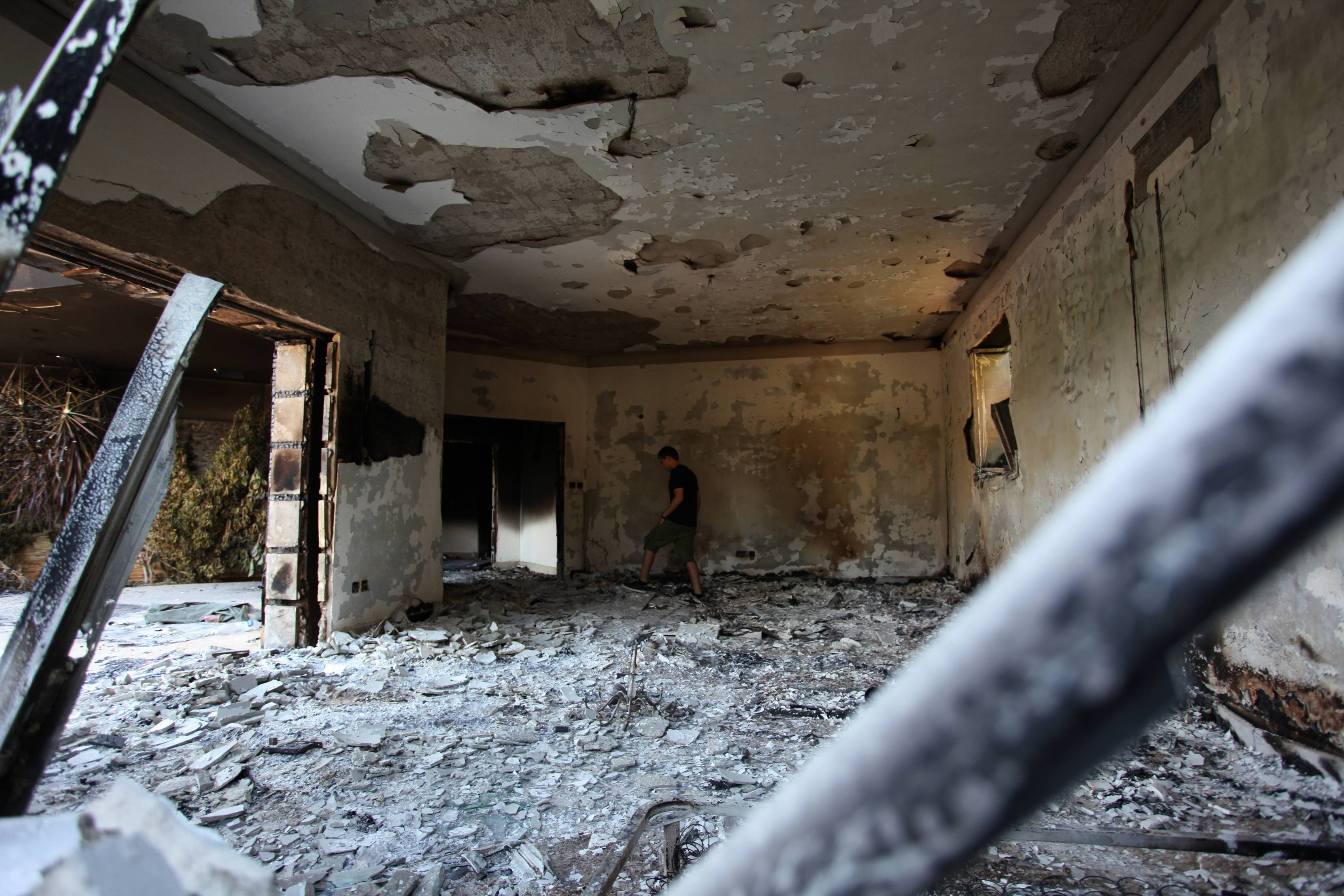This Sept. 13, 2012, file photo shows a man walking in the rubble of the damaged U.S. consulate, after an attack that killed four Americans, including Ambassador Chris Stevens on the night of Tuesday, Sept. 11, 2012, in Benghazi, Libya.