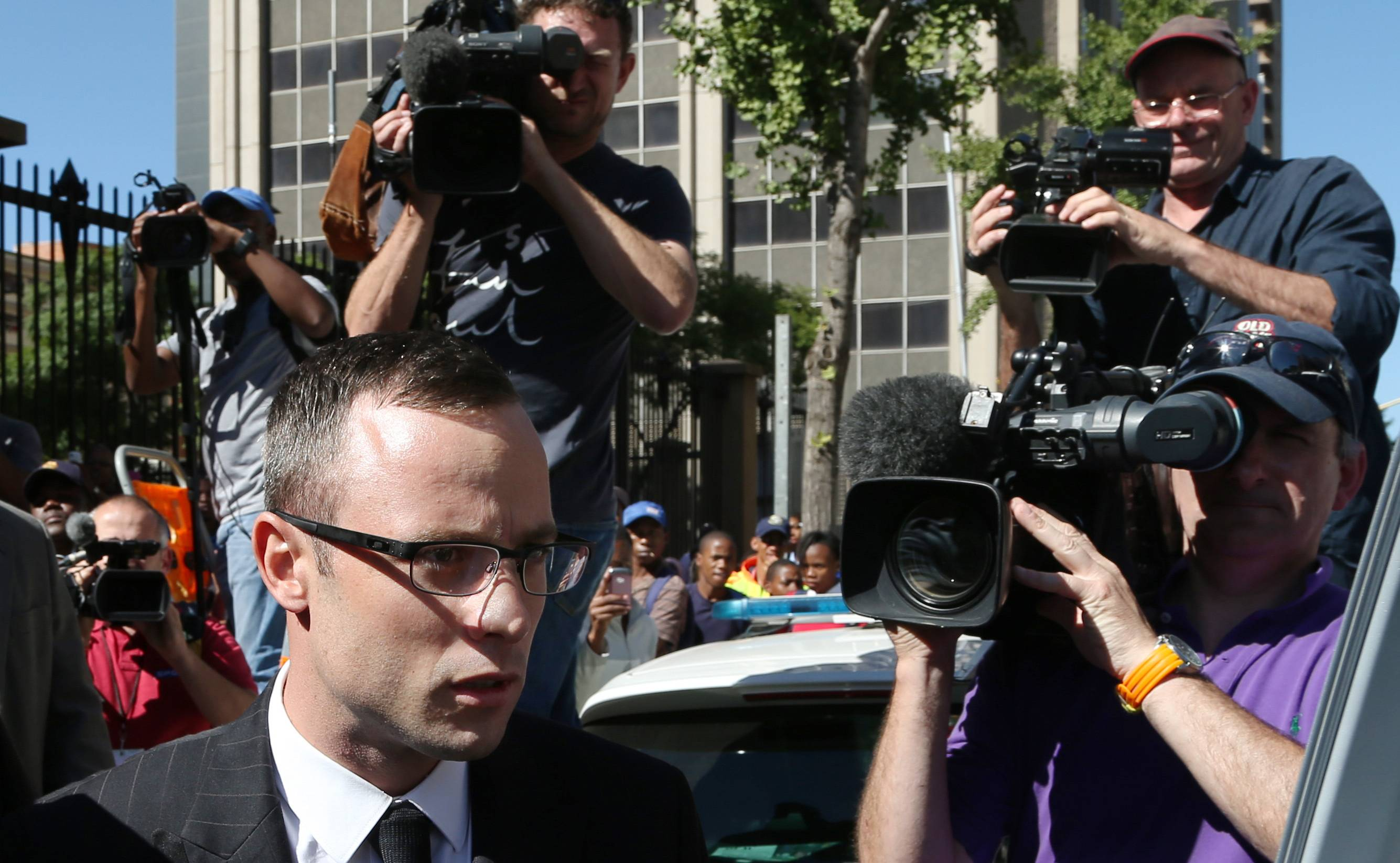 Oscar Pistorius leaves the high court in Pretoria, South Africa, March 25. The murder trial of Pistorius is expected to enter a critical phase of testimony Monday as the defense attempts to overcome a faltering start and show how the disabled Olympic athlete fatally shot girlfriend Reeva Steenkamp by mistake because he was overwhelmed by a long-held fear of violent crime.