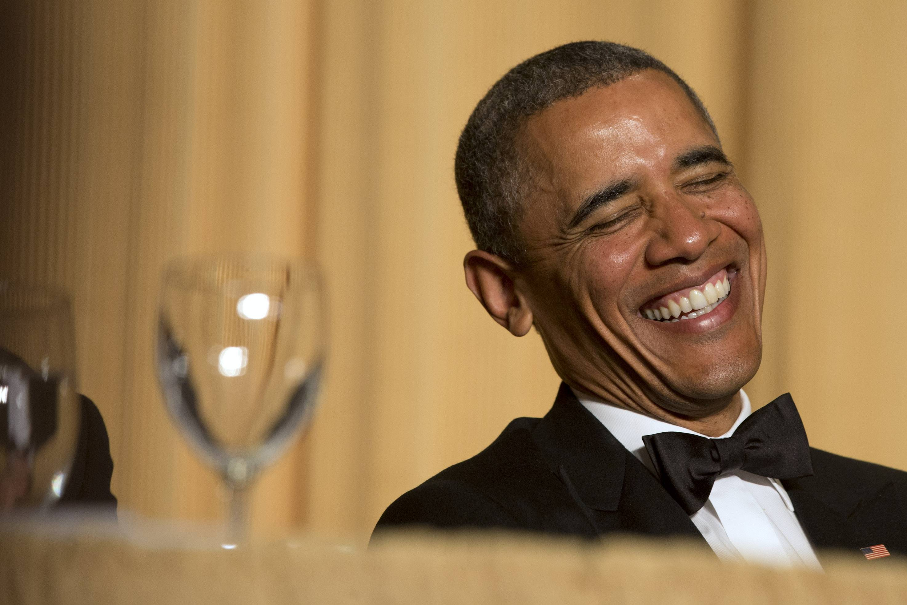 President Barack Obama laughs as actor and comedian Joel McHale speaks during the White House Correspondents' Association Dinner at the Washington Hilton Hotel Saturday in Washington.