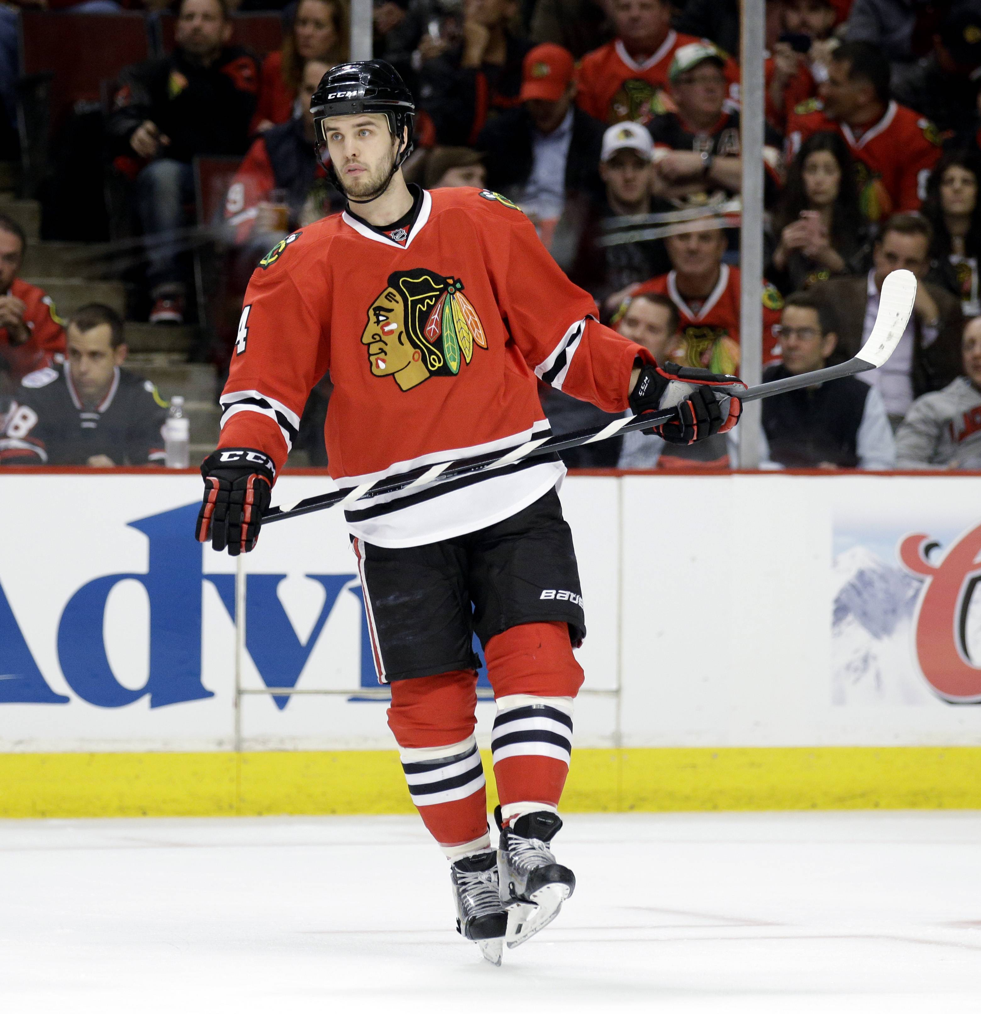 Blackhawks defenseman Niklas Hjalmarsson barely skipped a shift after being injured in the first period doing what he does best — blocking a shot.