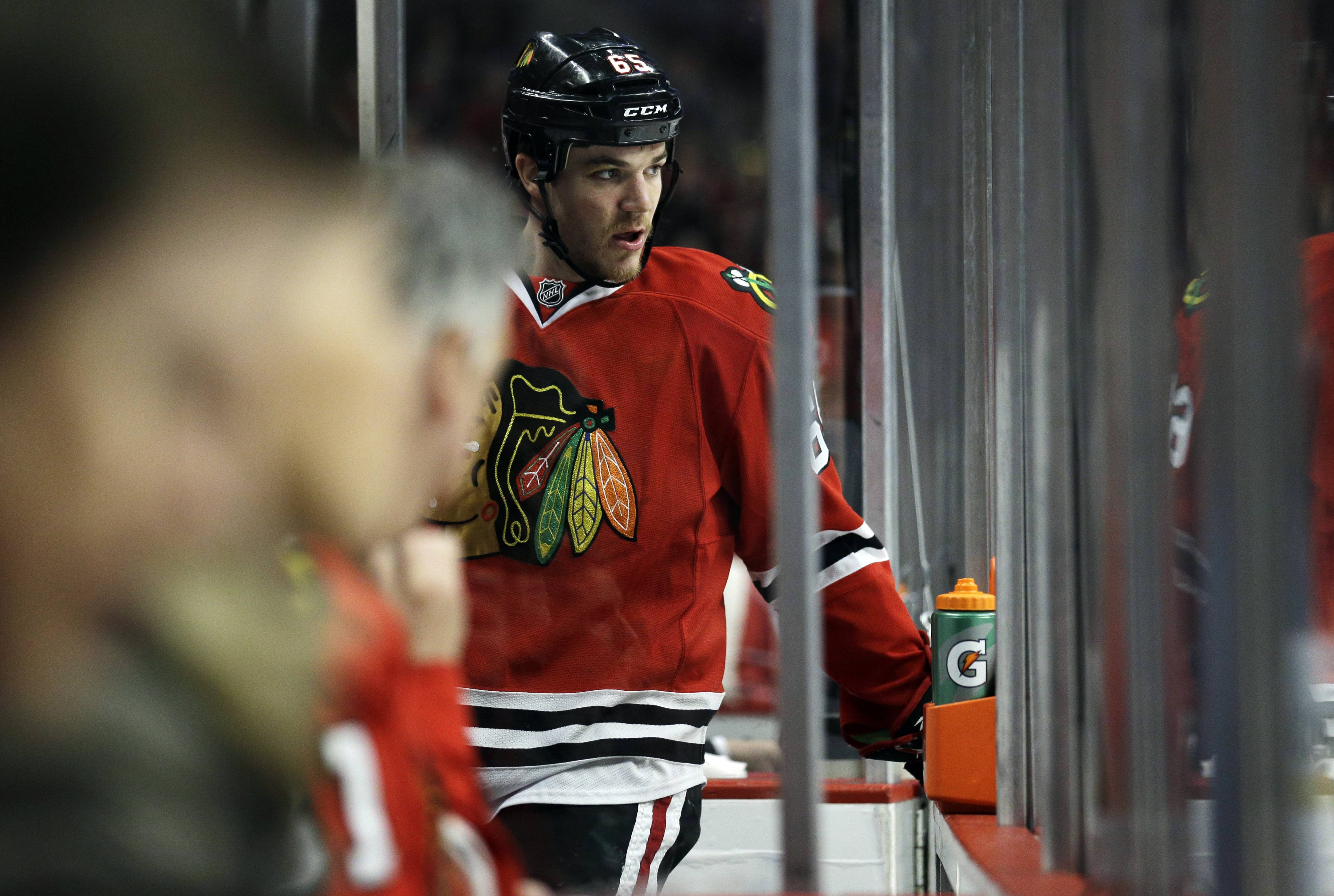 Chicago Blackhawks' Andrew Shaw (65) watches his teammates during the first period in Game 1 of an NHL hockey second-round playoff series against the Minnesota Wild in Chicago, Friday, May 2, 2014. (AP Photo/Nam Y. Huh)