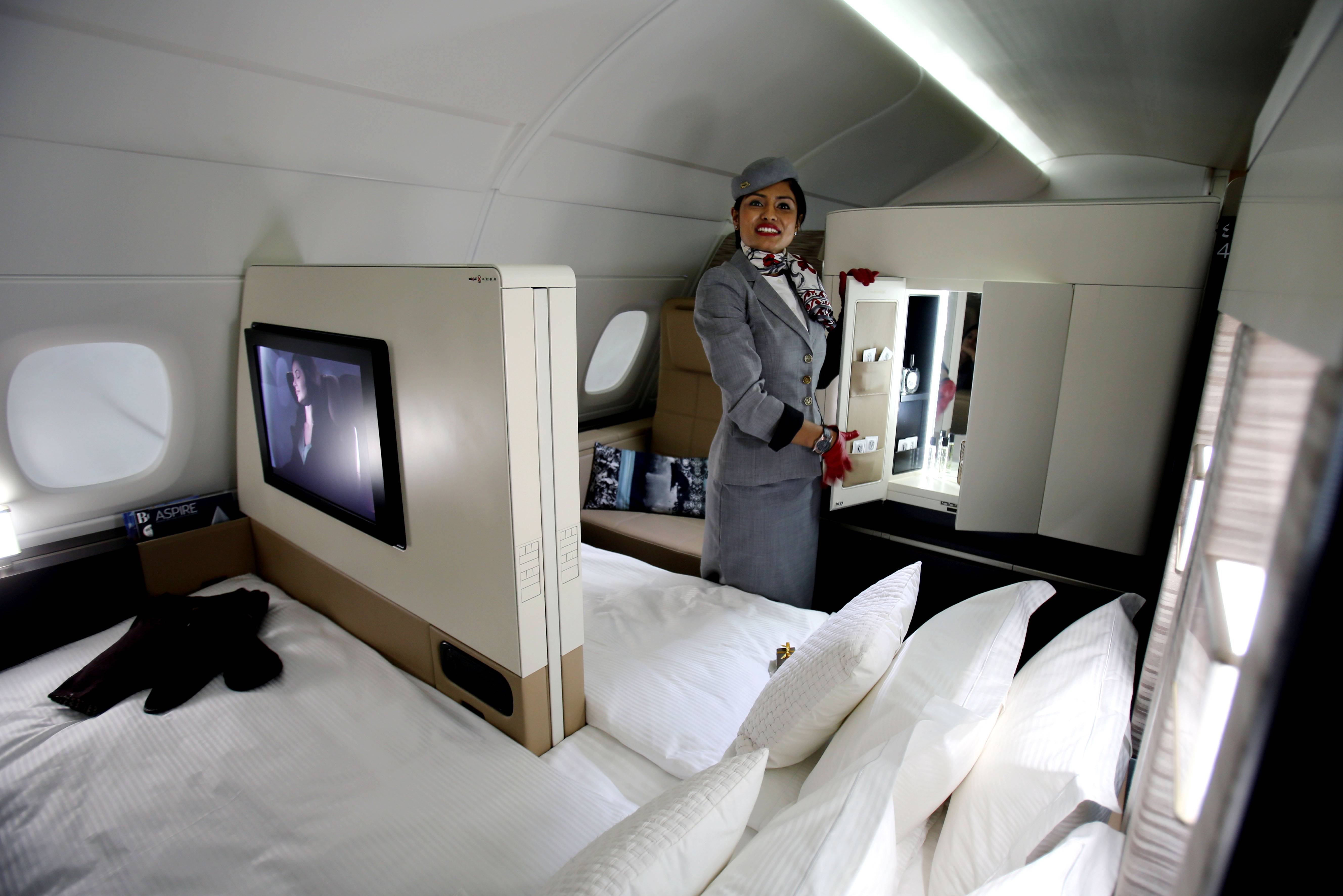 An Etihad Airways official stands inside a mock-up first class cabin, at a training facility in Abu Dhabi, United Arab Emirates, Sunday. Etihad Airways, a fast-growing Mideast carrier, plans to offer passengers a miniature suite featuring a closed-off bedroom, private bathroom and a dedicated butler.