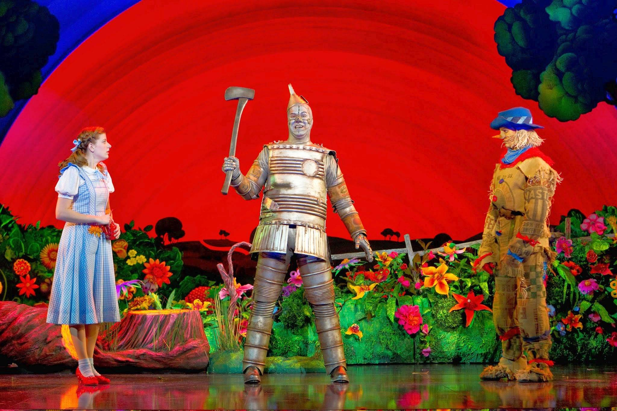 "Dorothy (Danielle Wade) and the Scarecrow (Jamie McKnight, right) encounter the Tin Man (Mike Jackson) in the national tour of ""The Wizard of Oz"" now at the Cadillac Palace Theatre in Chicago through May 11."