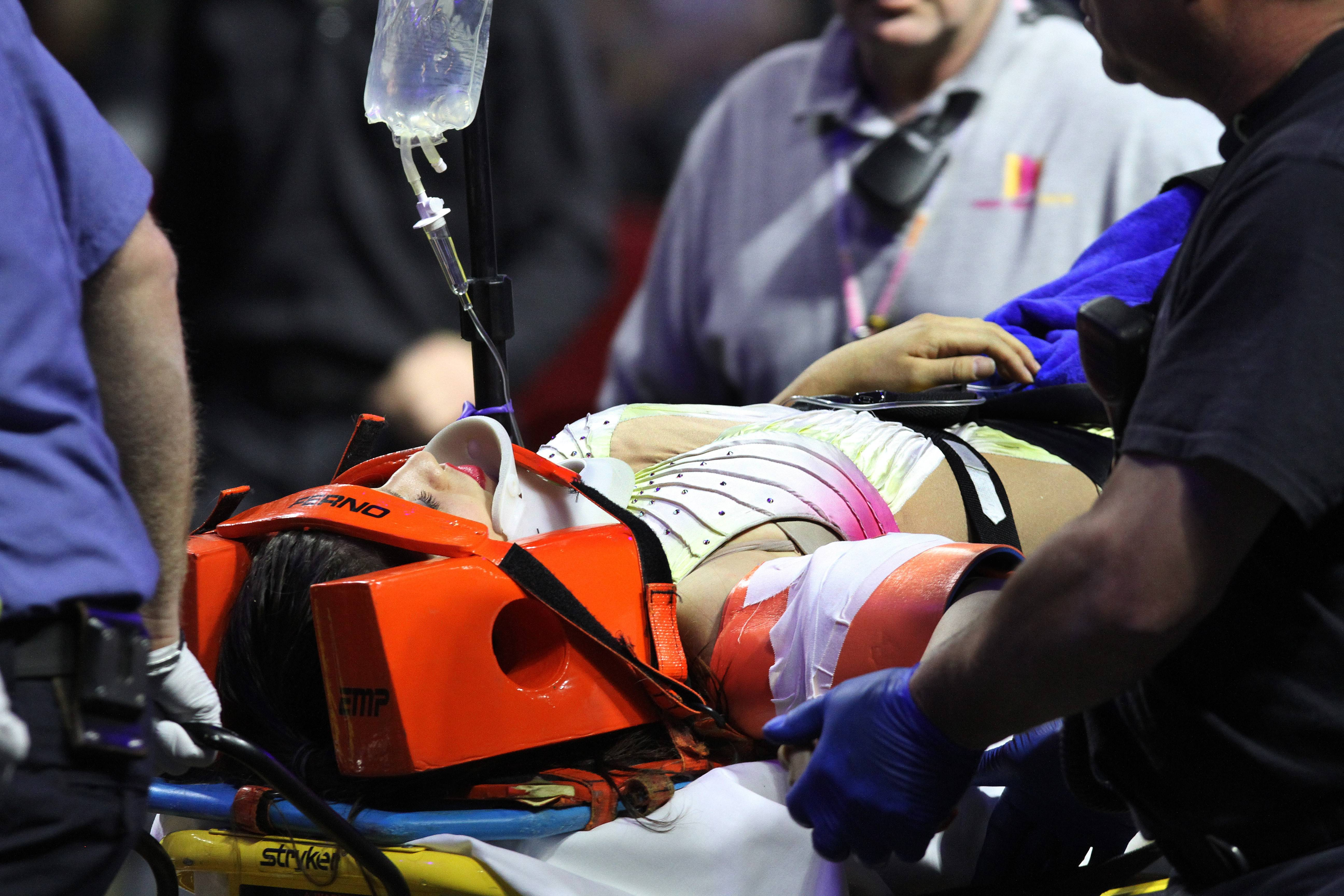 An injured female performer is lifted onto a stretcher after a platform collapsed during an aerial hair-hanging stunt at the Ringling Brothers and Barnum and Bailey Circus Sunday in Providence, R.I. At least nine performers were seriously injured in the fall, including a dancer below.