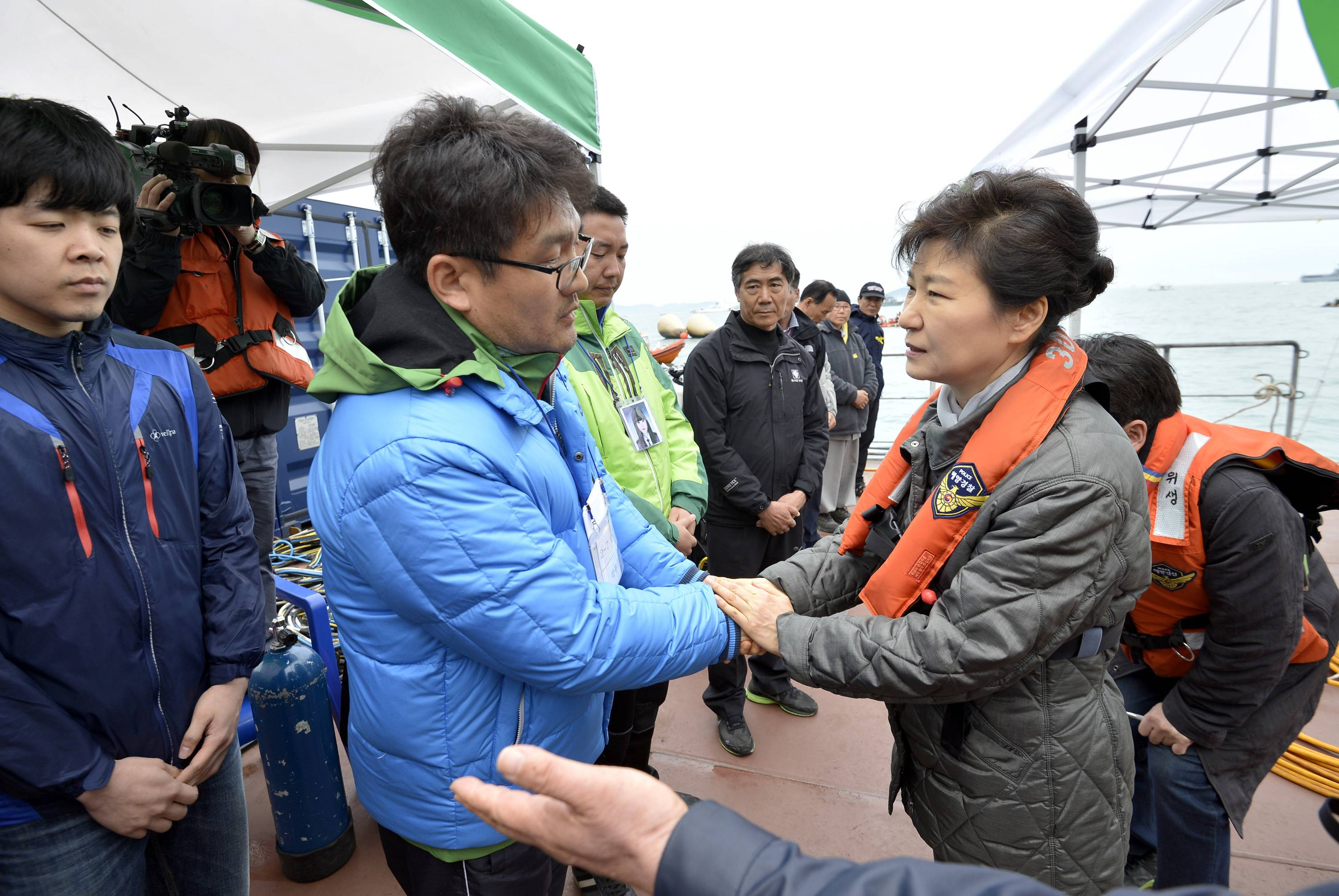 South Korean President Park Geun-hye, right, consoles a relative of a passenger aboard the sunken Sewol ferry at the site where the ship sank in waters off the southern coast near Jindo, South Korea, Sunday. Park told families of those missing in the sunken ferry that her heart breaks knowing what they are going through, as divers recovered two more bodies on Sunday.