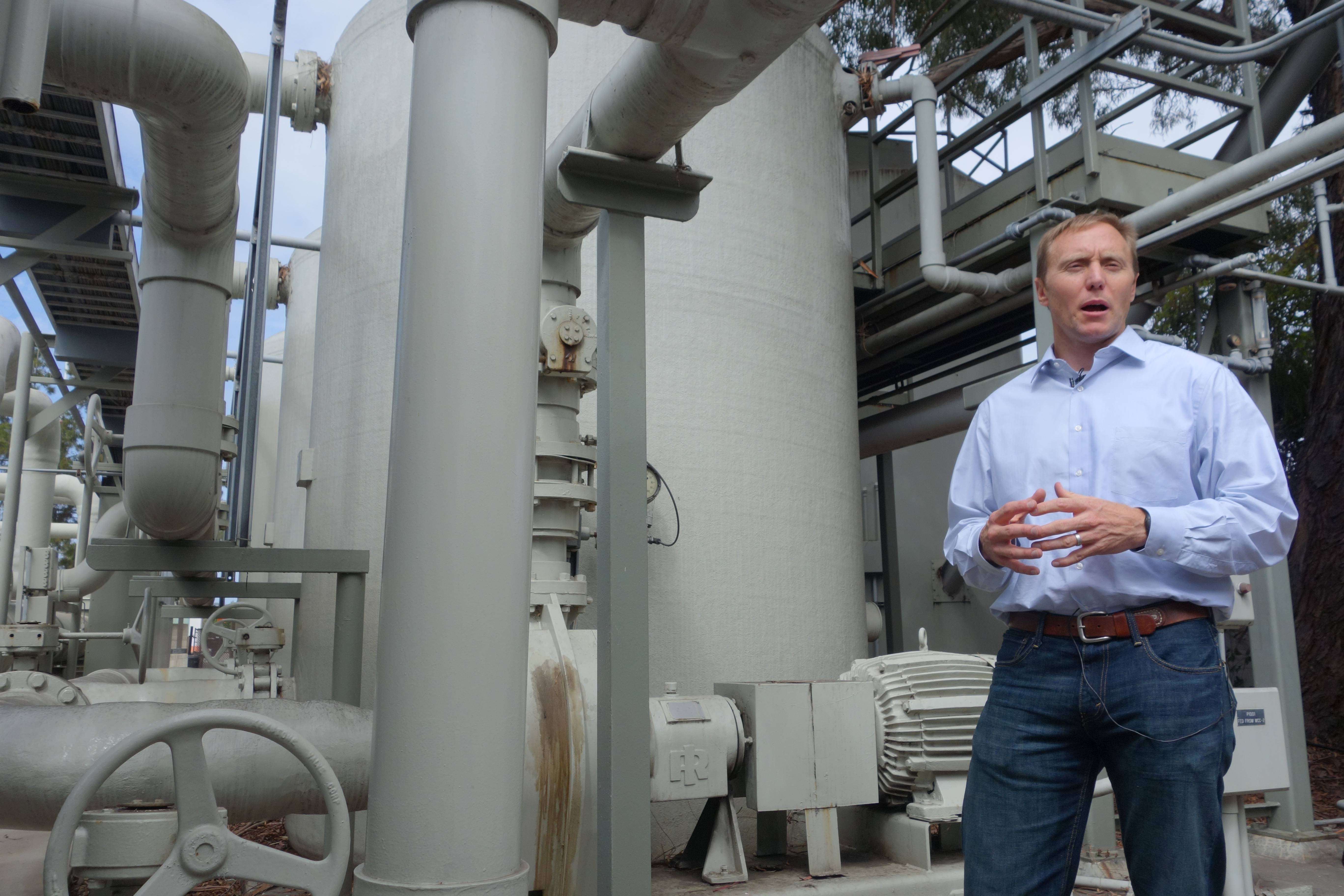 Joshua Haggmark, interim resources manager for Santa Barbara, Calif., stands next to a desalination plant, which removes salt from ocean water, in Santa Barbara, Calif.  The city is considering restarting the plant as California withers in a drought.