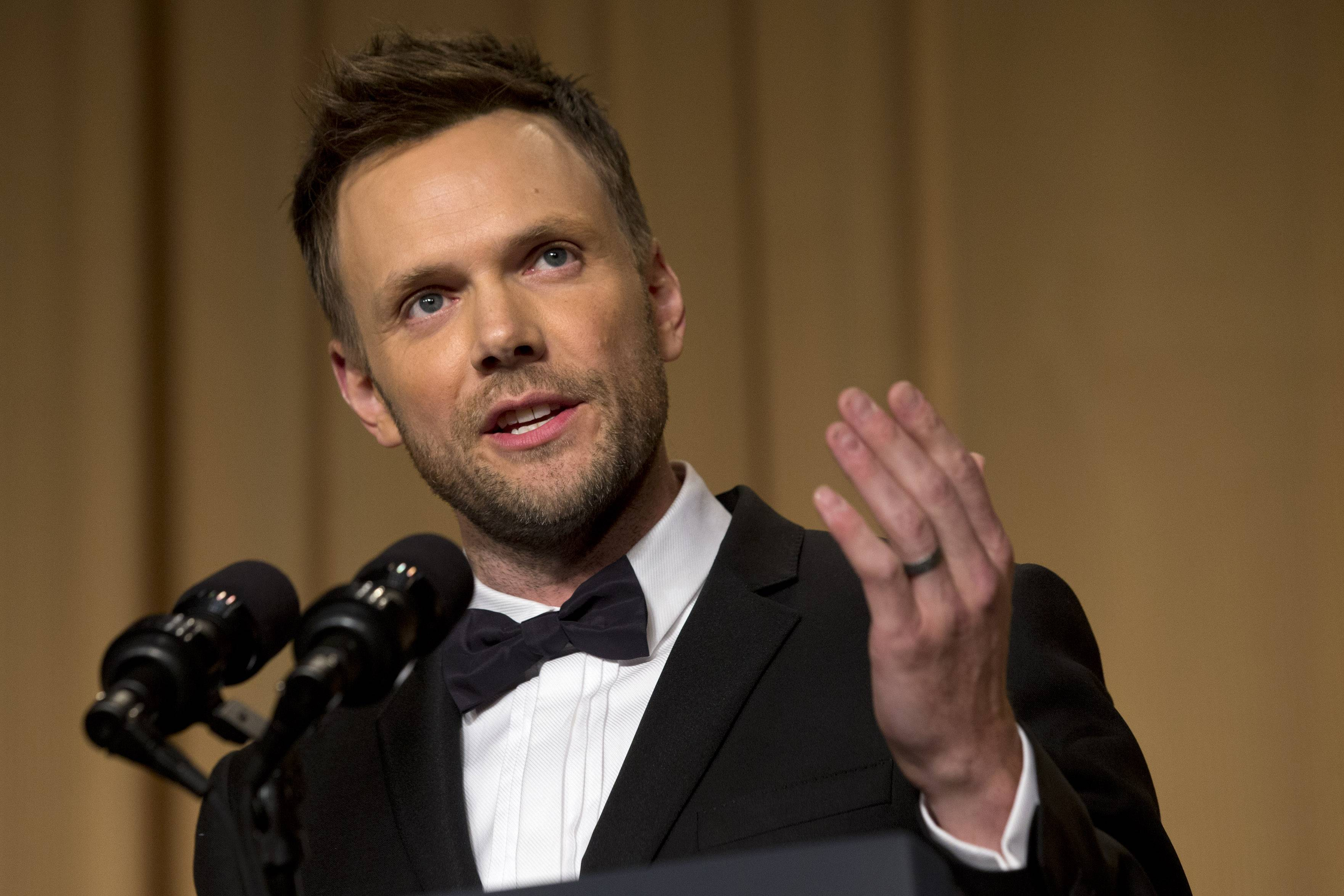 Actor and comedian Joel McHale makes jokes at the centennial dinner of the White House Correspondents' Association at the Washington Hilton Hotel Saturday.