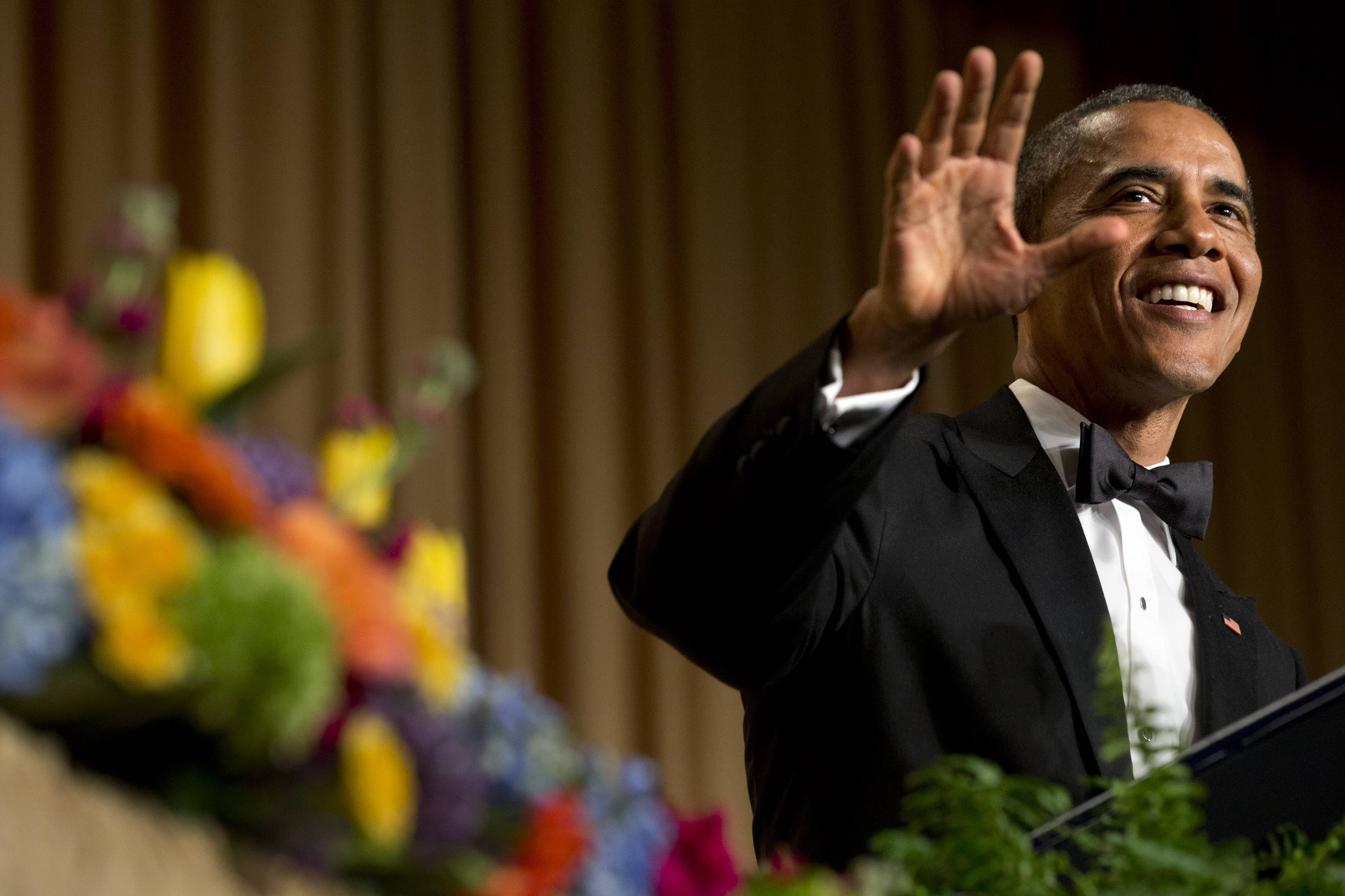 President Barack Obama gestures and smiles during his speech at the White House Correspondents' Association Dinner at the Washington Hilton Hotel Saturday in Washington.
