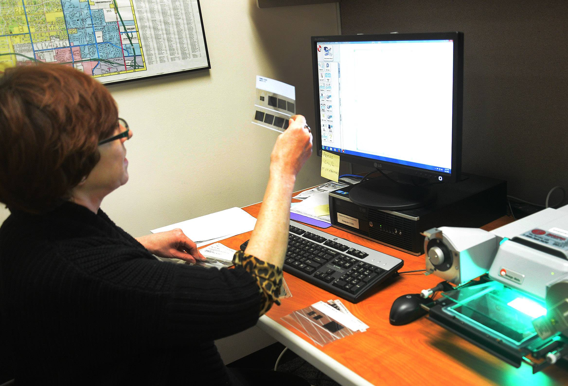 Jane Lentino, Schaumburg permit control clerk, tracks down information for a FOIA request.