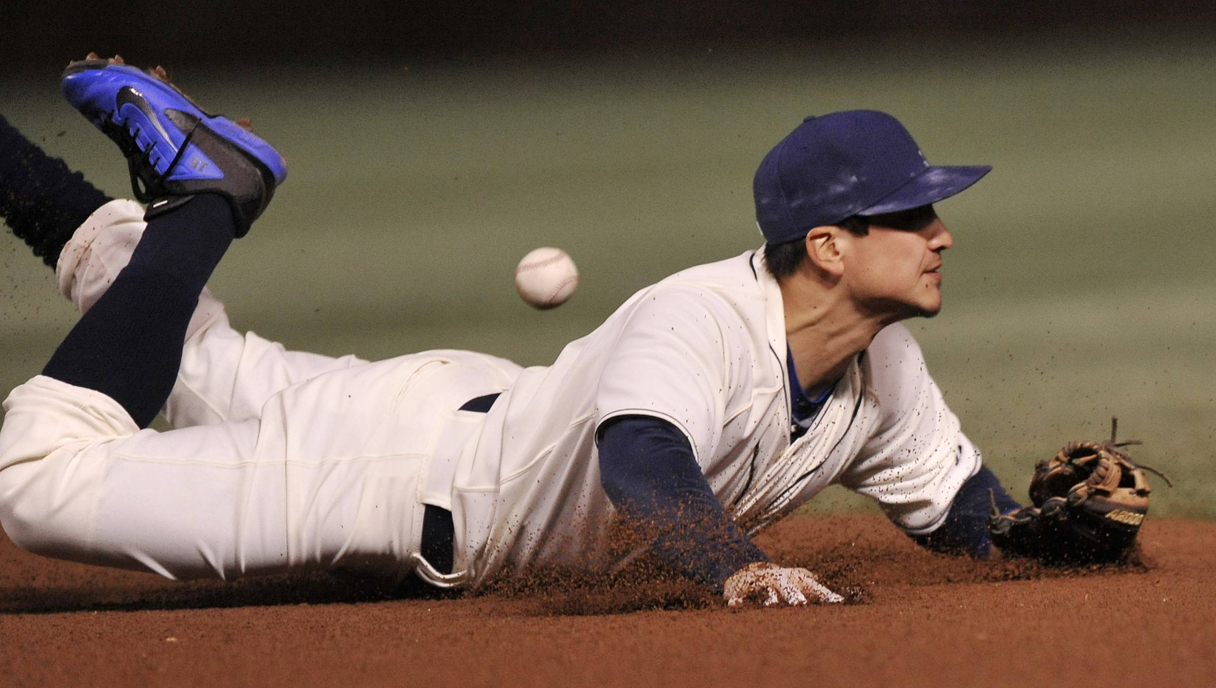 Cubs second baseman Darwin Barney dives but can't corral a single hit by the Cardinals' Matt Carpenter in the sixth inning Sunday night at Wrigley Field.