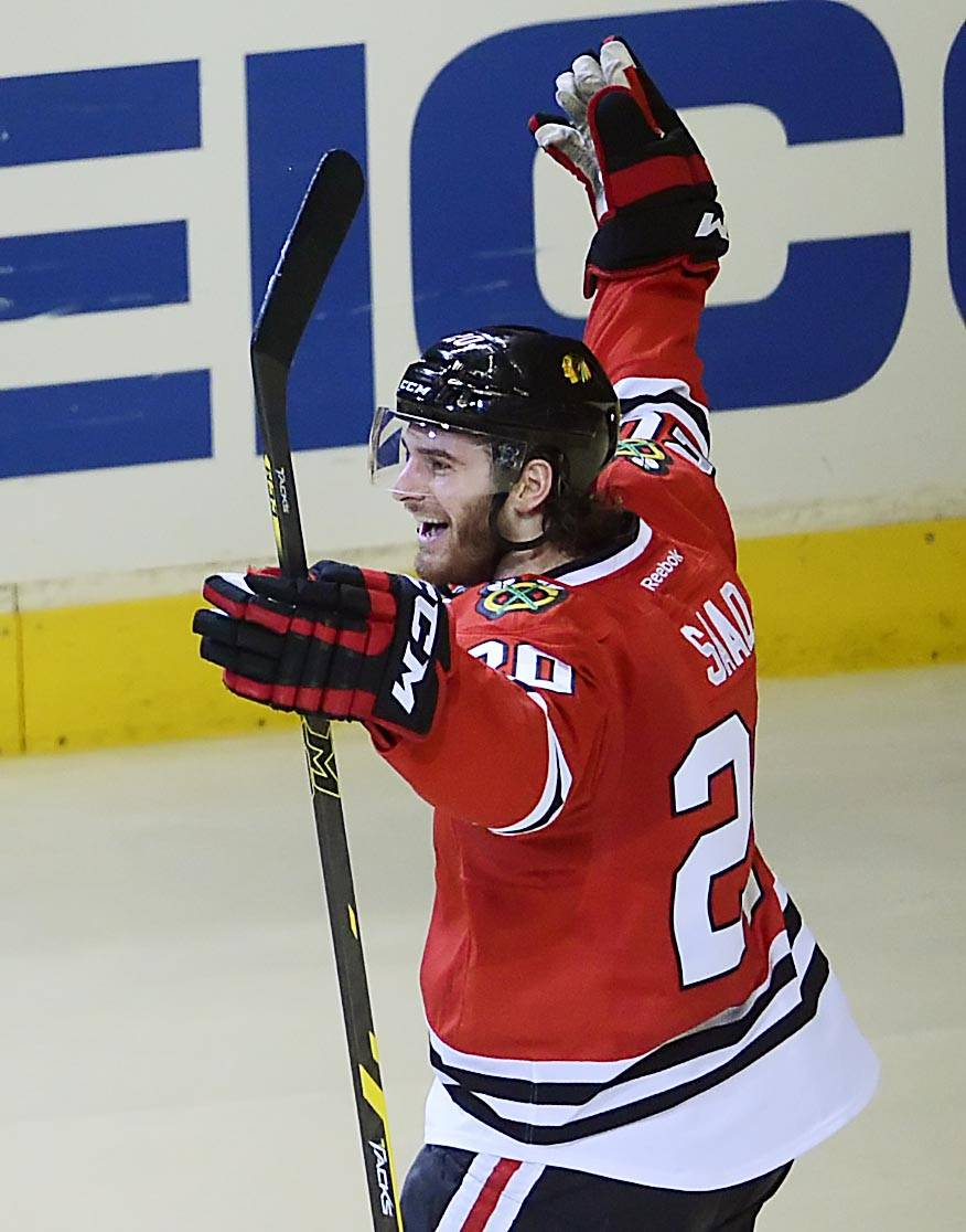 The Hawks' Brandon Saad celebrates his first goal of the playoffs Sunday against the Wild in the second period at the United Center. Saad added an empty-net goal in the third period.
