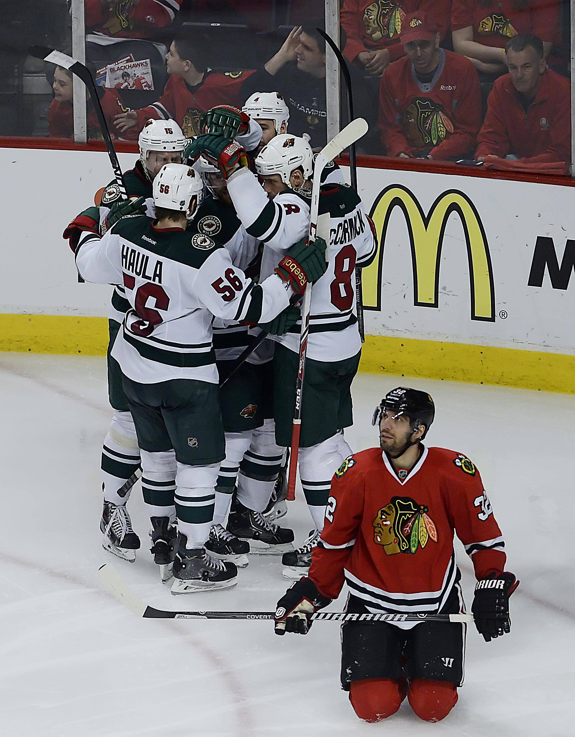 Chicago Blackhawks defenseman Michal Rozsival kneels on the ice after Minnesota Wild center Cody McCormick scored in the third period. Chicago won 4-1.