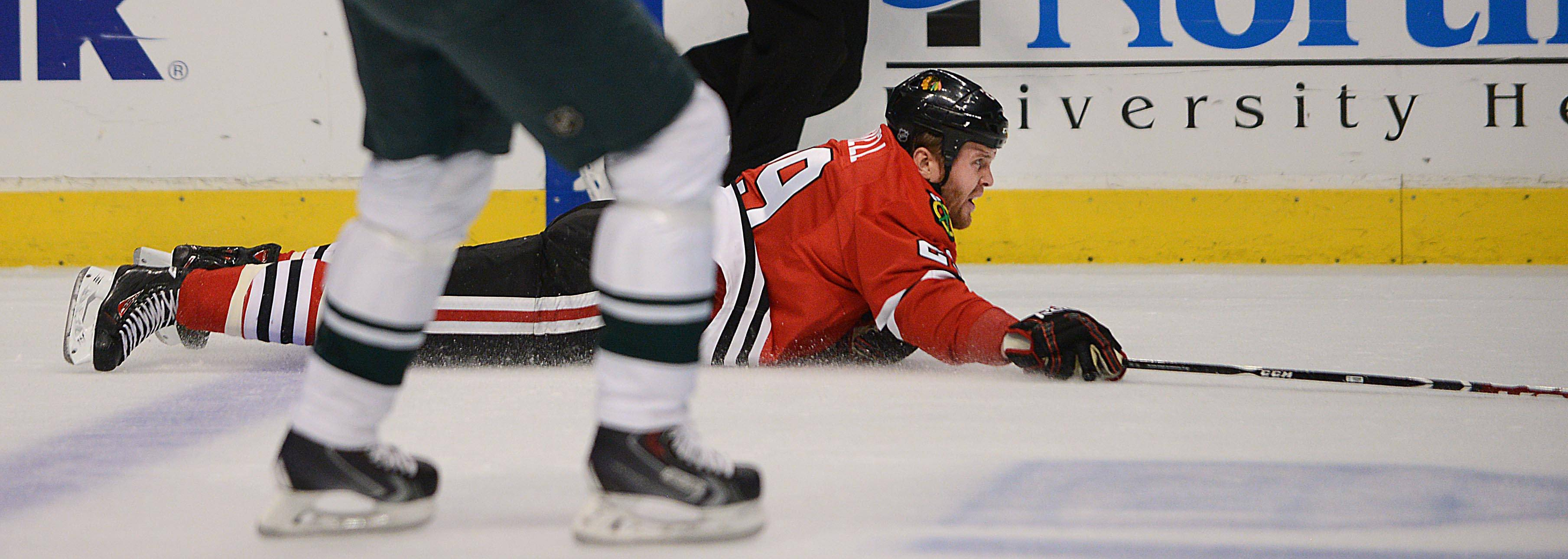 Chicago Blackhawks left wing Bryan Bickell hits the ice against the Minnesota Wild.