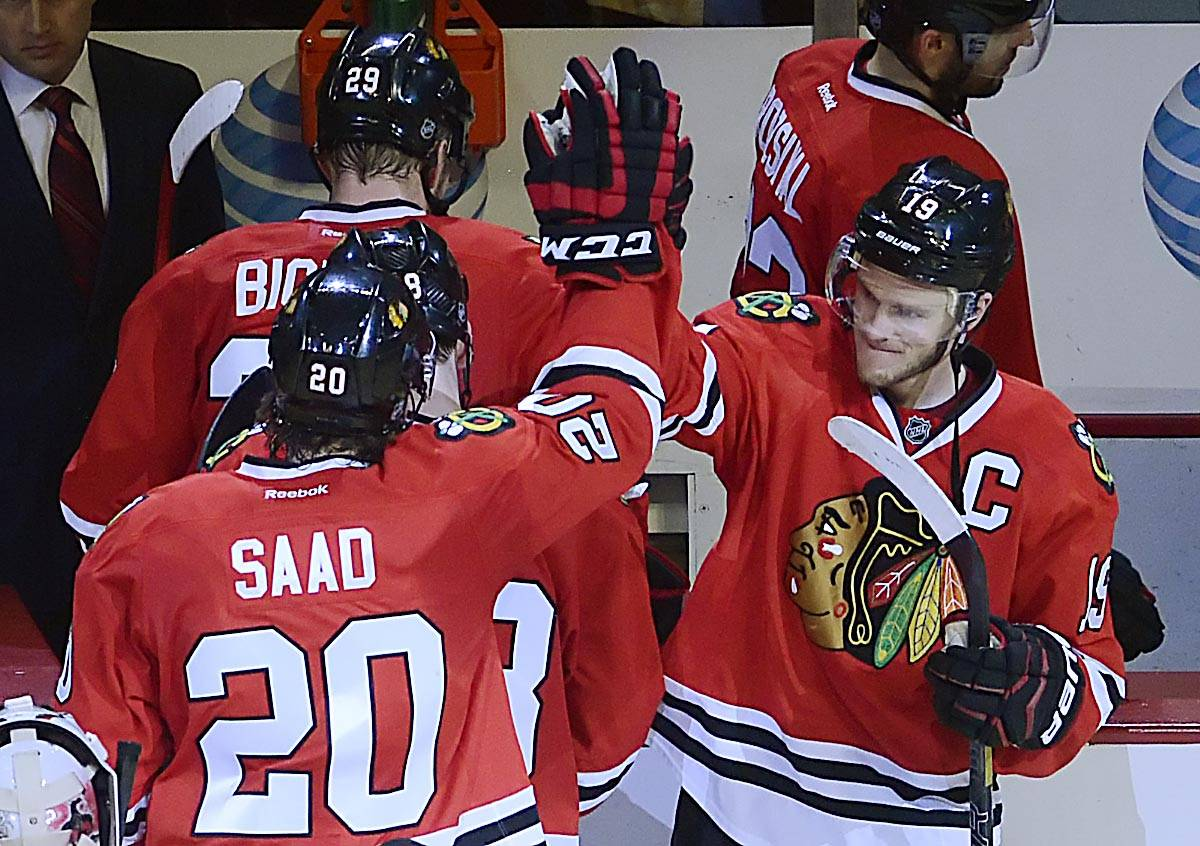 Chicago Blackhawks center Jonathan Toews high-fives Brandon Saad as the team comes off the ice after beating the Minnesota Wild 4-1. Saad scored twice.