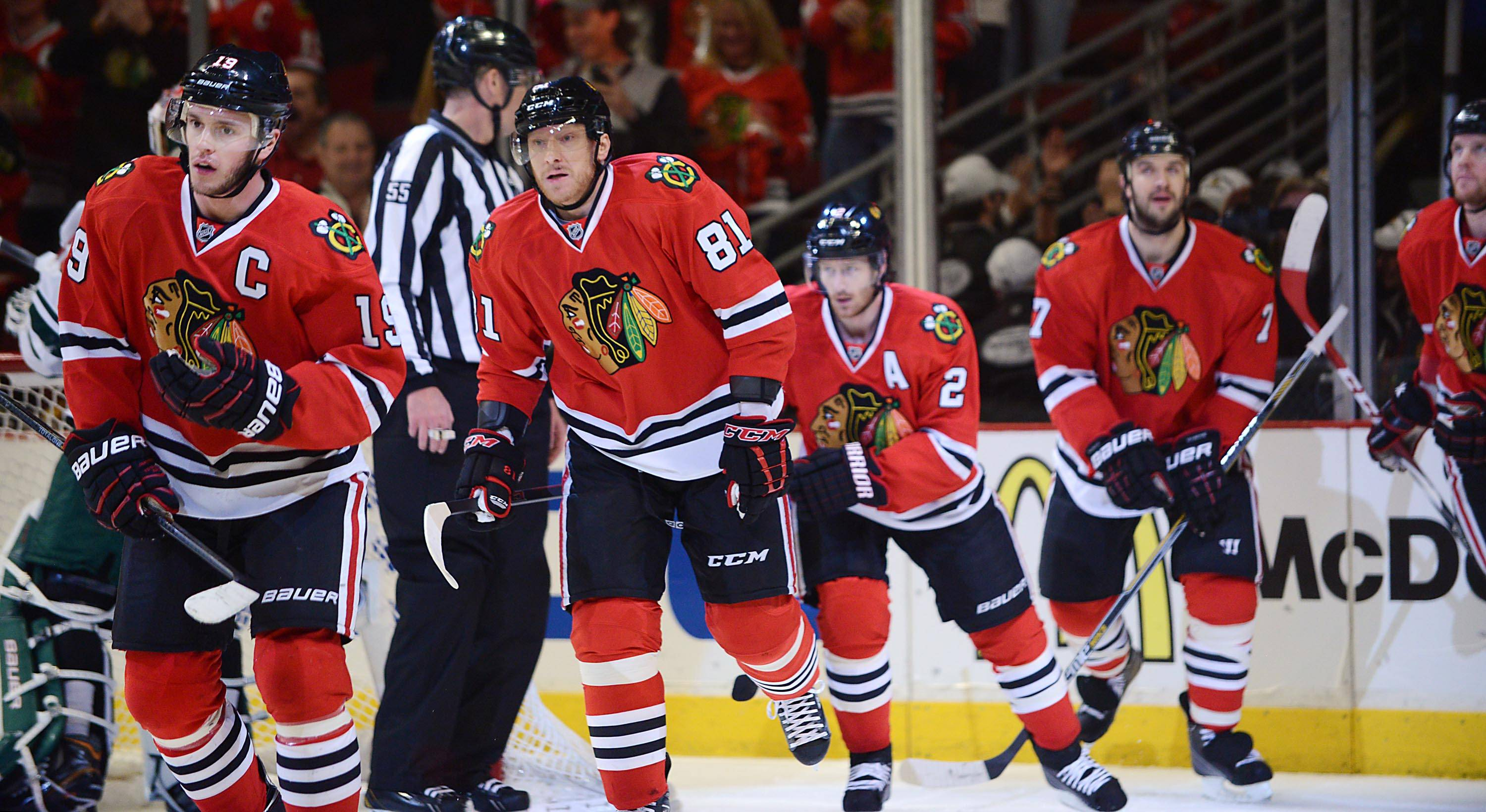 Chicago Blackhawks center Jonathan Toews leads his line off the ice after scoring in the first period.