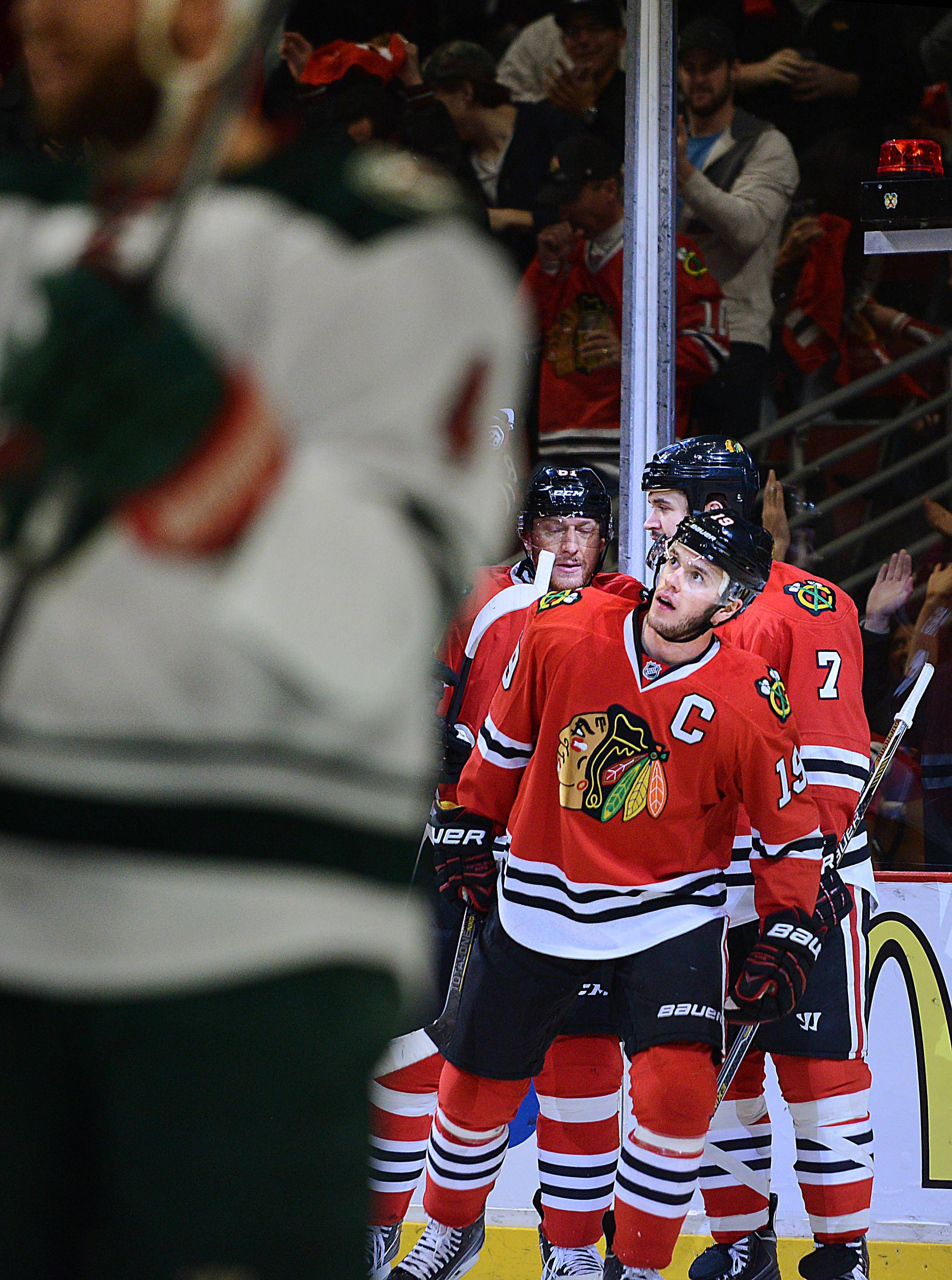 Chicago Blackhawks center Jonathan Toews looks toward the scoreboard after his goal against the Minnesota Wild.