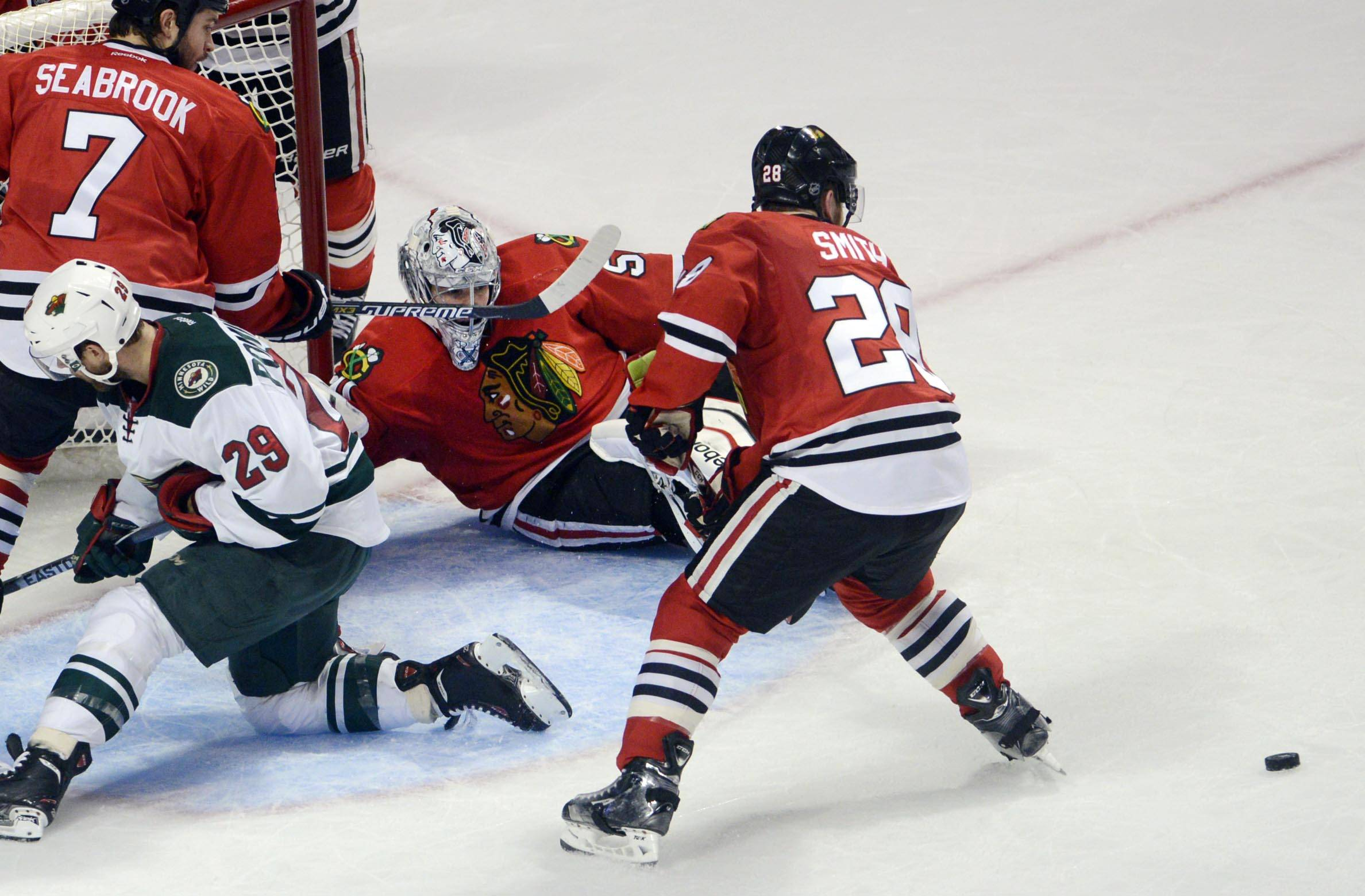 Chicago Blackhawks goalie Corey Crawford redirects the puck Sunday against the Minnesota Wild.