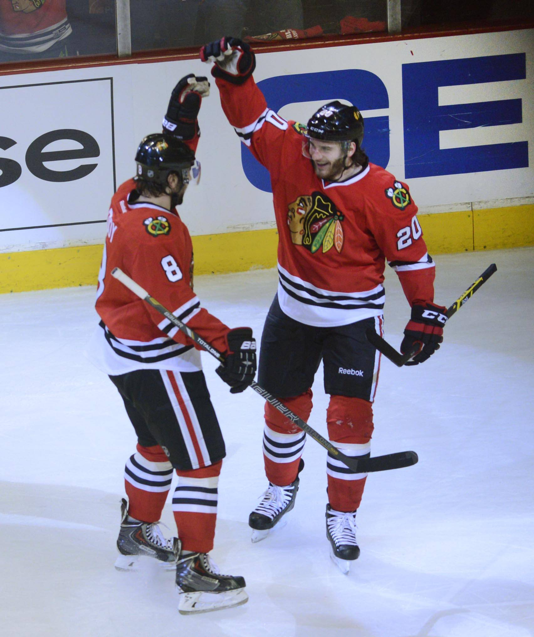 Chicago Blackhawks left wing Brandon Saad celebrates his goal with teammate Nick Leddy.