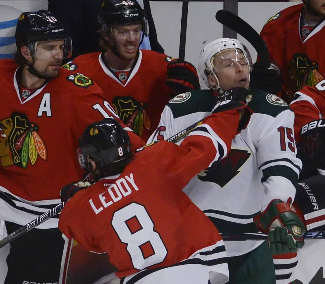 Chicago Blackhawks defenseman Nick Leddy lands a punch to the chin of Minnesota Wild left wing Dany Heatley Sunday.