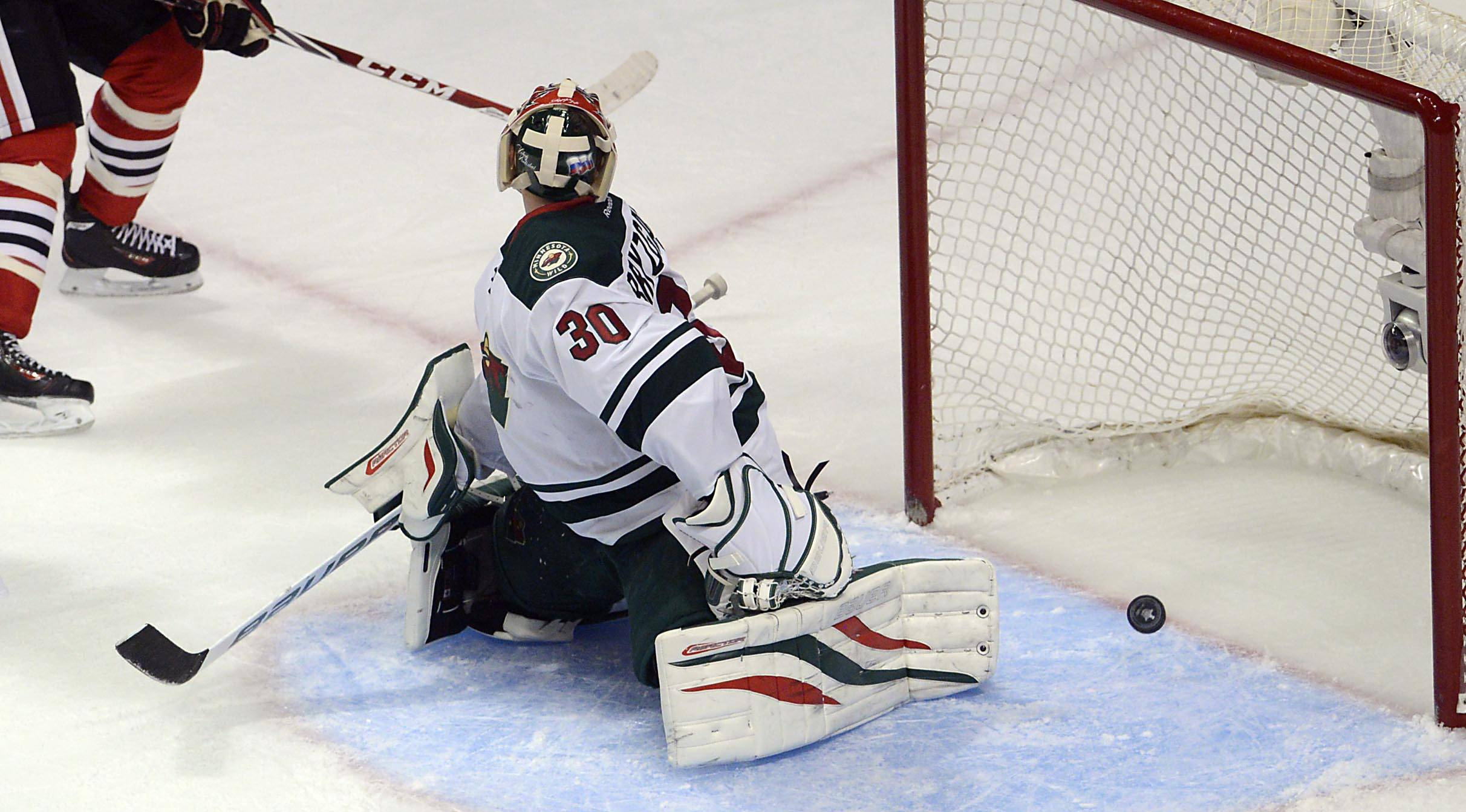 Minnesota Wild goalie Ilya Bryzgalov doesn't see Chicago Blackhawks left wing Brandon Saad's goal go in the net.