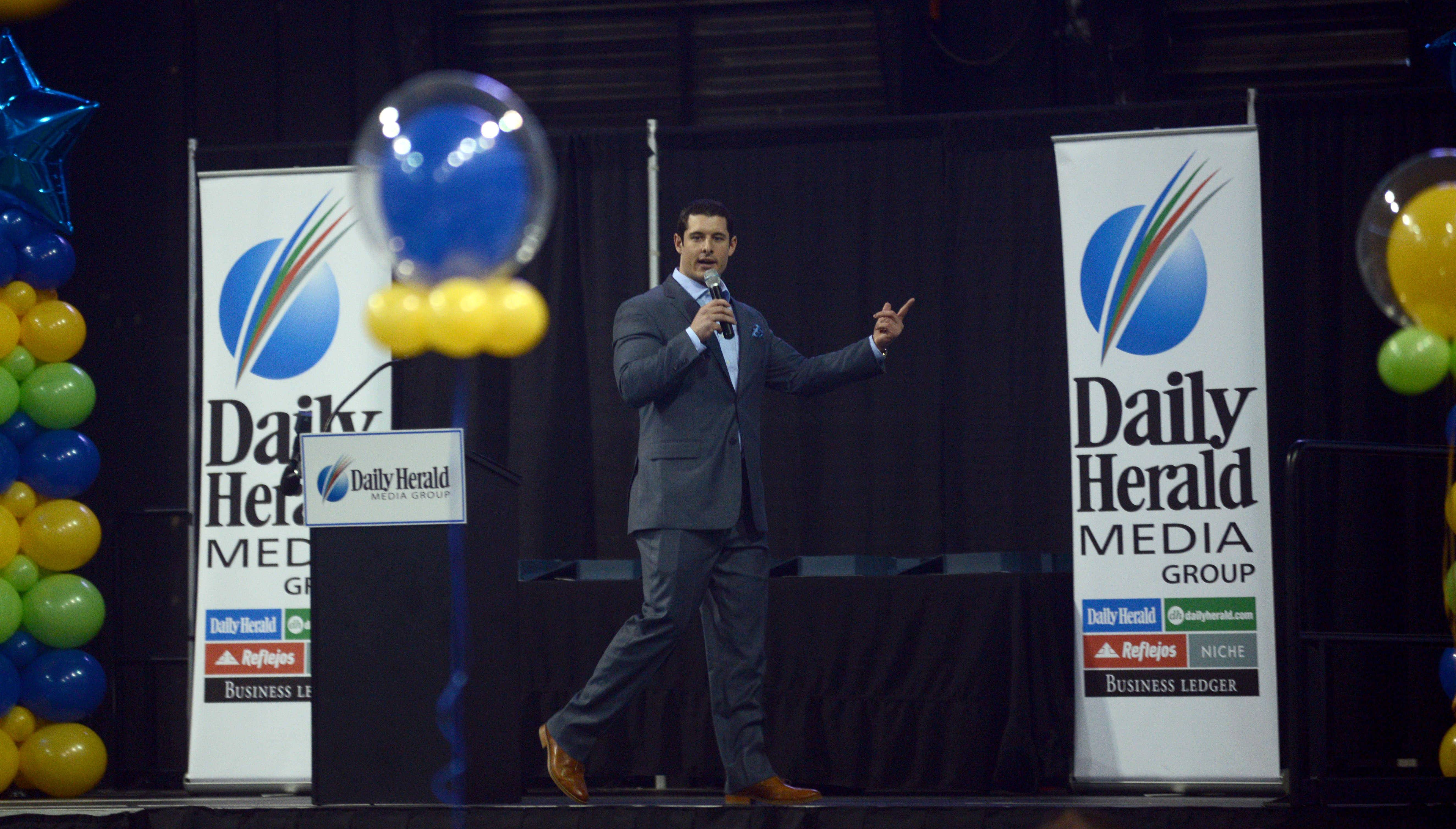 Keynote speaker Matt Mayberry offers his remarks during the Daily Herald Prep Sports Excellence event at the Sears Centre in Hoffman Estates on Sunday afternoon.